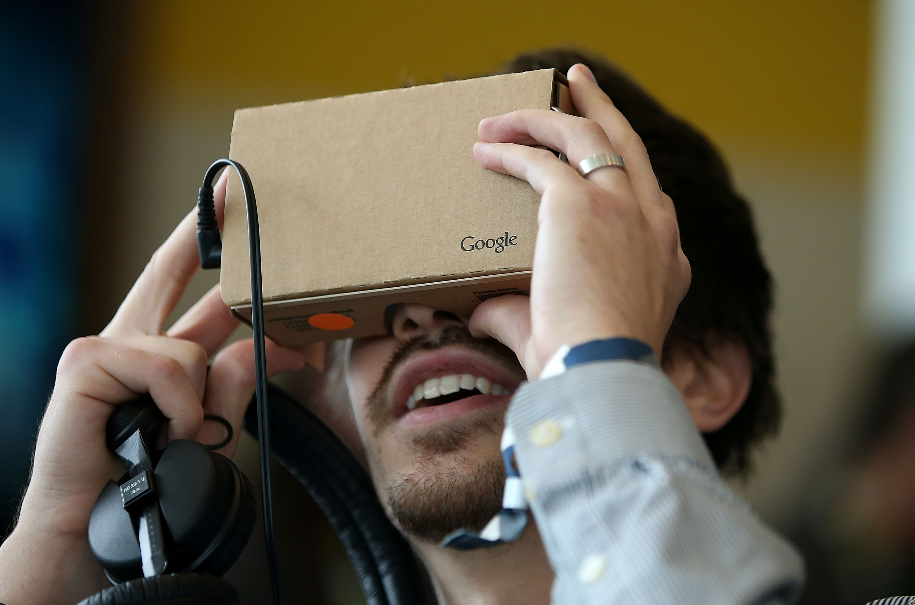 An attendee inspects Google Cardboard during the 2015 Google I/O conference on May 28, 2015 in San Francisco, Calif.