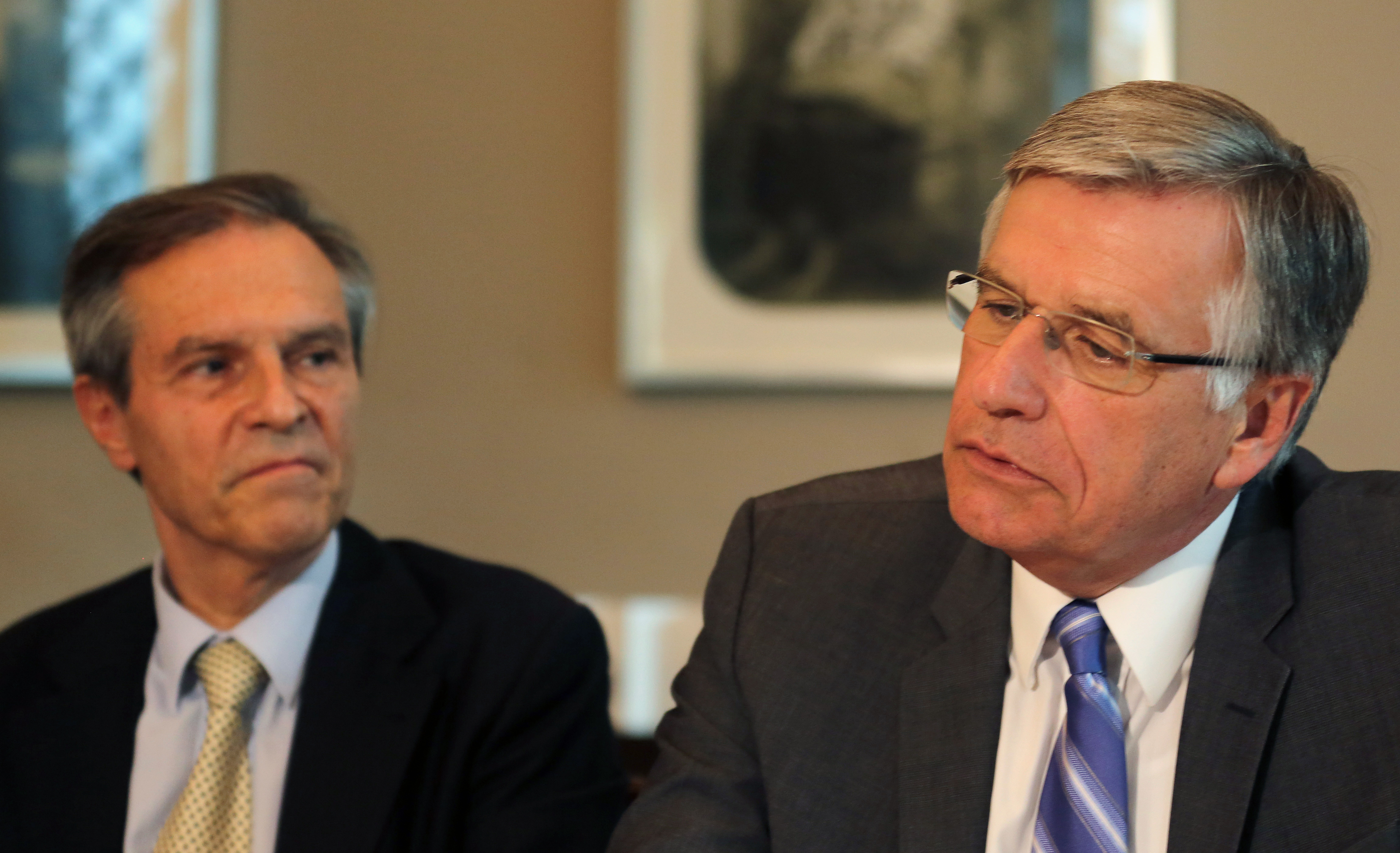 German Ambassador to India, Michael Steiner (L) listens to Dr. Hubert Lienhard (R), Chairman of the Asia-Pacific Committee of German Business (APA), speaking during a joint news conference in New Delhi, India, 11 July 2014.