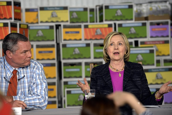Democratic presidential candidate Hillary Clinton speaks at a business roundtable at the Smuttynose Brewery with co-owner Peter Egelston May 22, 2015 in Hampton, New Hampshire.