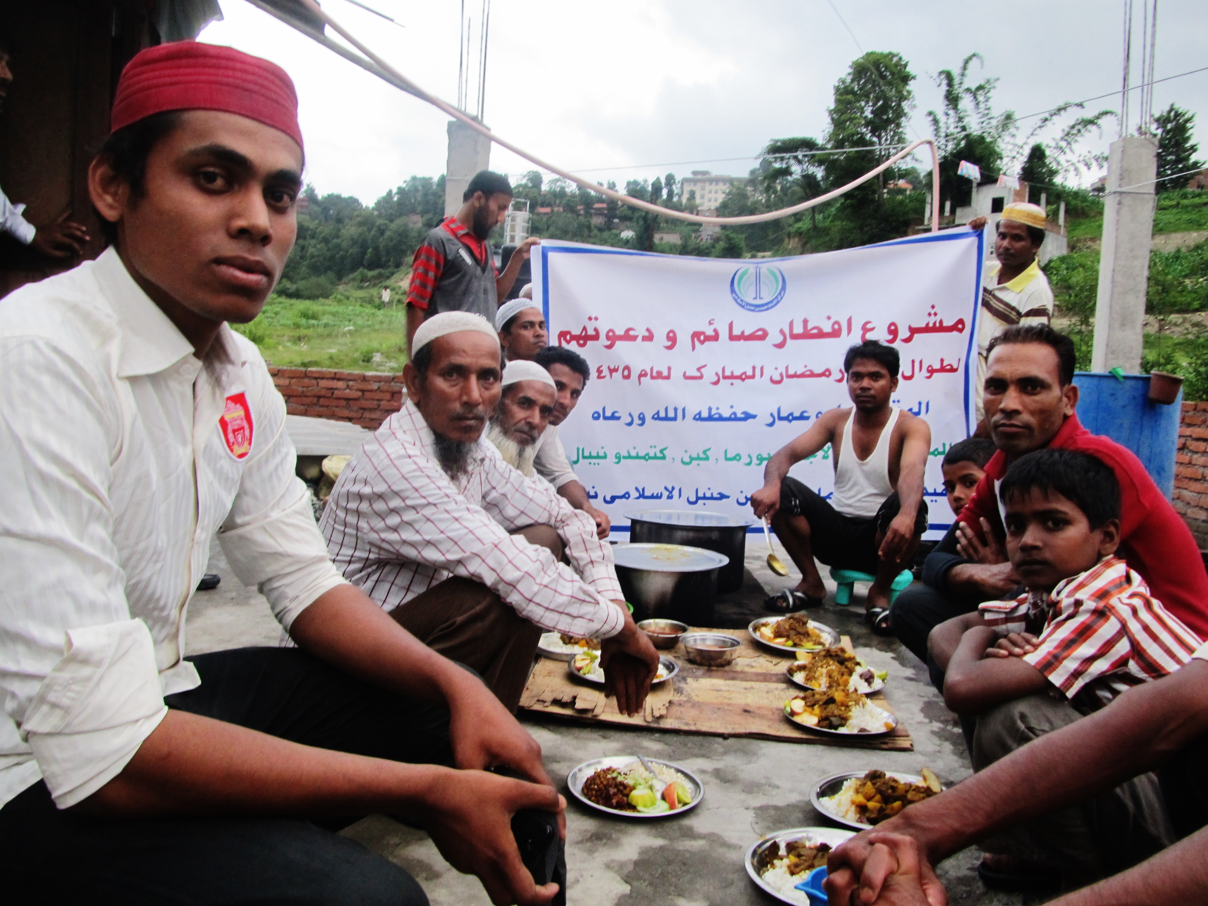 Hassan Hassan, left, with fellow Rohingya refugees on the outskirts of Kathmandu in July 2014
