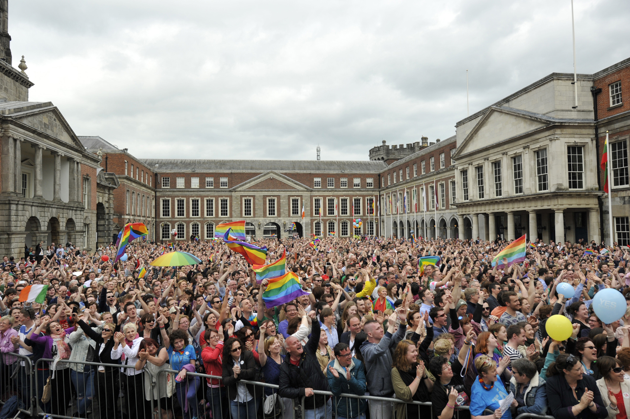 People celebrate a landslide victory of a Yes vote after a referendum on same sex marriage was won by popular ballot vote by a margin of around two-to-one at Dublin Castle on May 23, 2015 in Dublin.