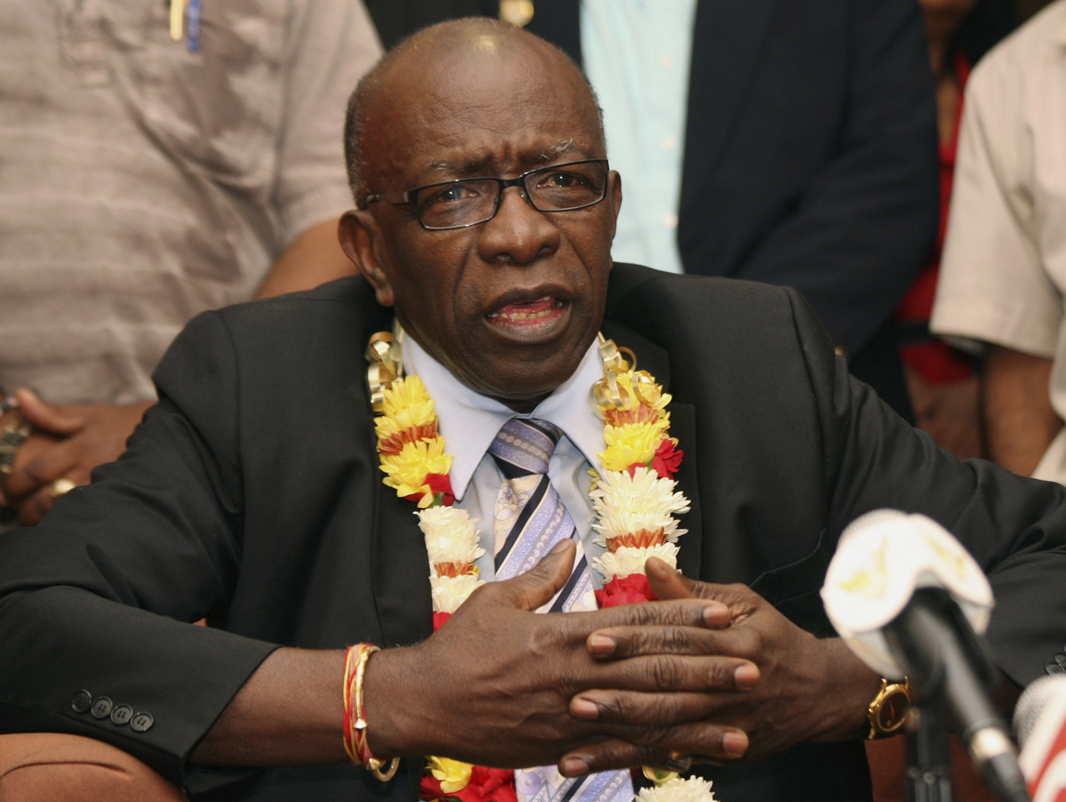 FIFA executive Jack Warner gestures during a news conference held shortly after his arrival at the airport in Port-of-Spain, in his native Trinidad and Tobago on June 2, 2011.