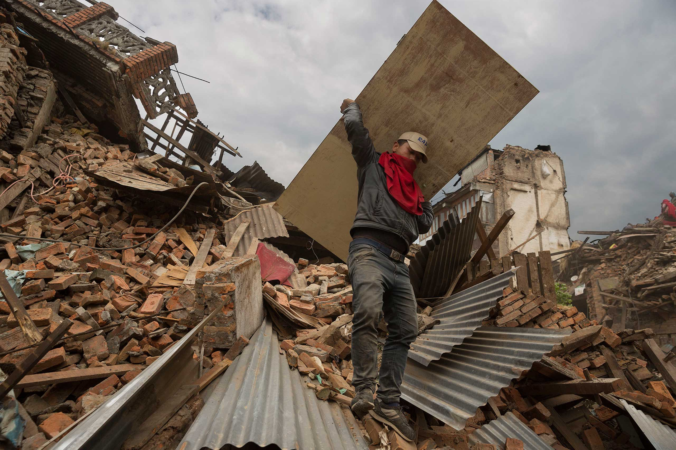 A man sorts through the wreckage of destroyed homes in the ancient city of Bhaktapur, near Kathmandu, April 28, 2015.
