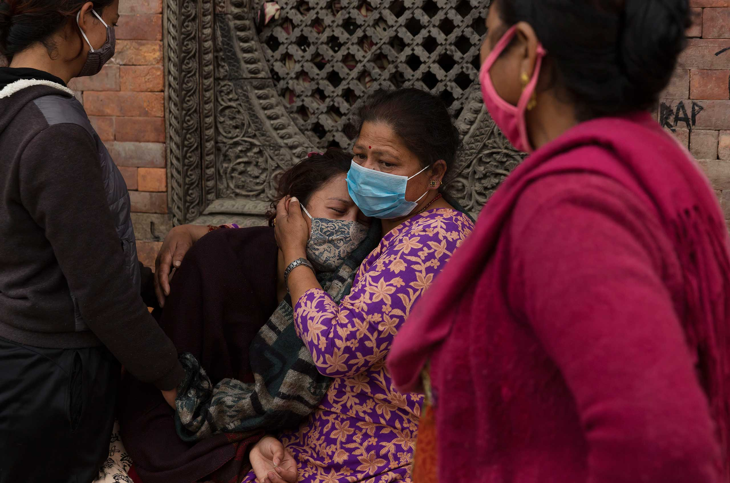 During funeral rites in Kathmandu on April 28, 2015, women mourn for loved ones killed in the earthquake.