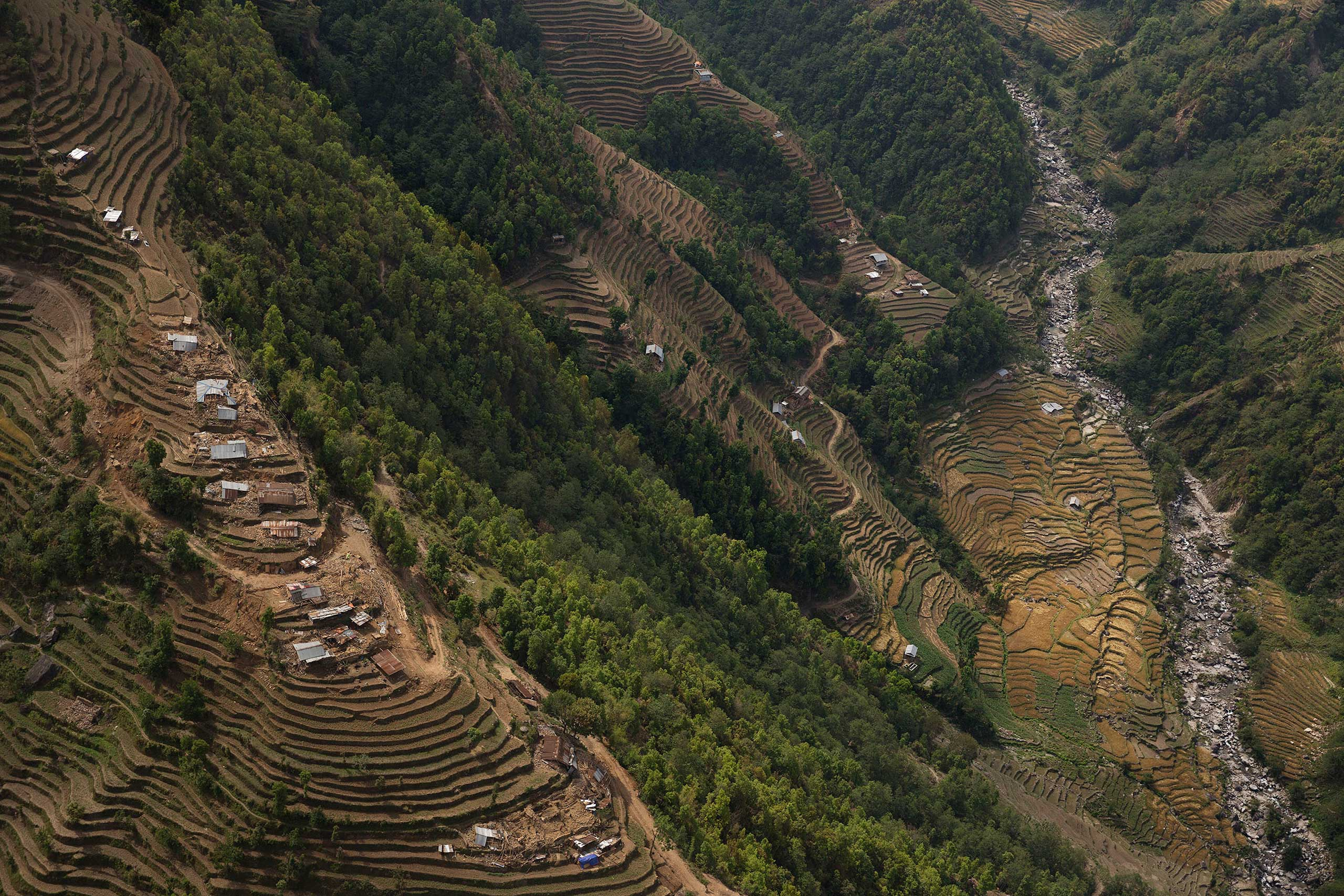 Destroyed farming villages are seen from a helicopter during an Indian Army relief mission to Nepal's remote Nuwakot District, April 30, 2015.