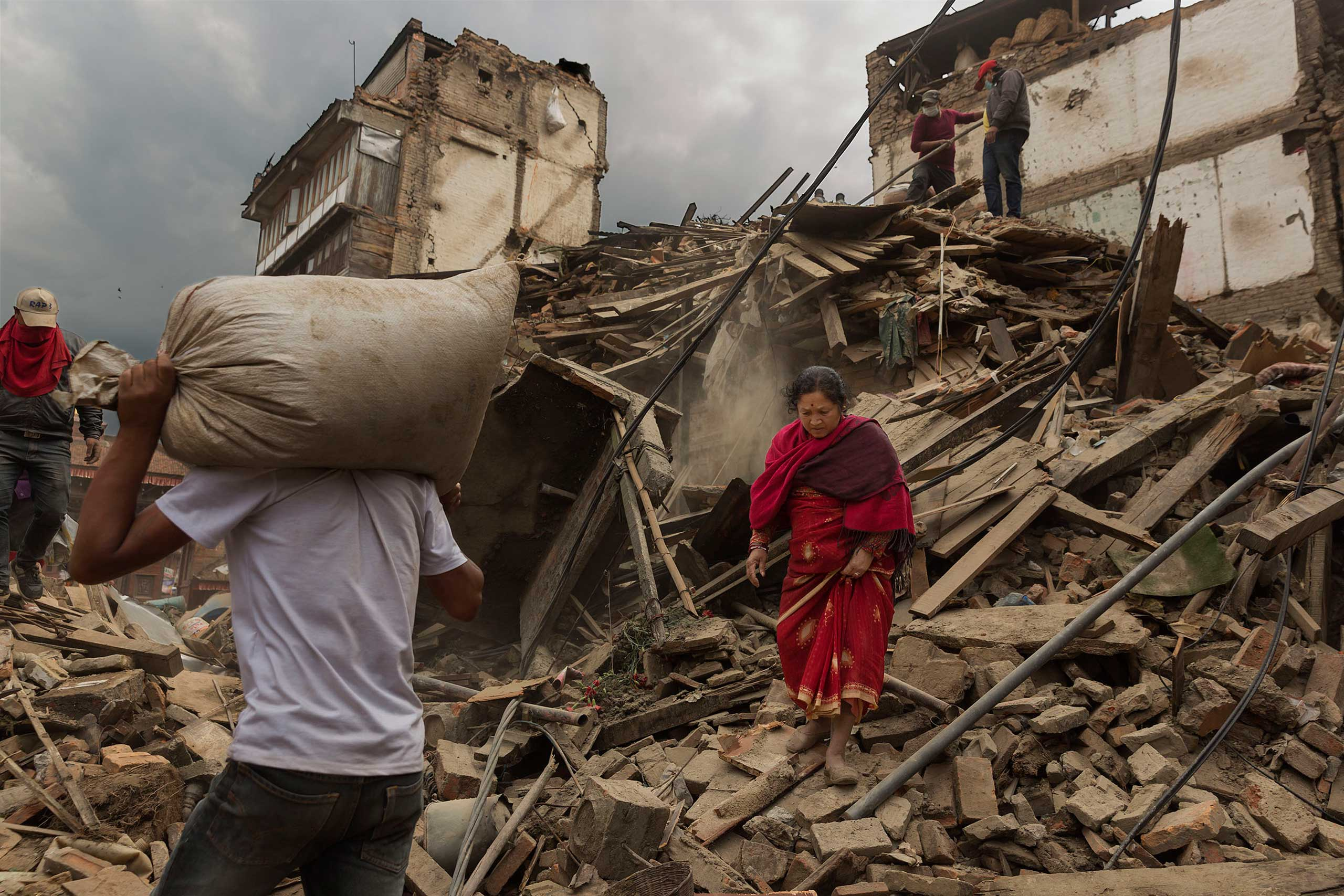 Residents search through the debris in Bhaktapur, April 28, 2015.