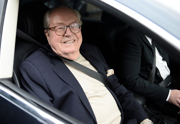 France's far-right party National Front's honorary president Jean-Marie Le Pen smiles as he leaves the party's headquarters in Nanterre, near Paris, on May 4, 2015