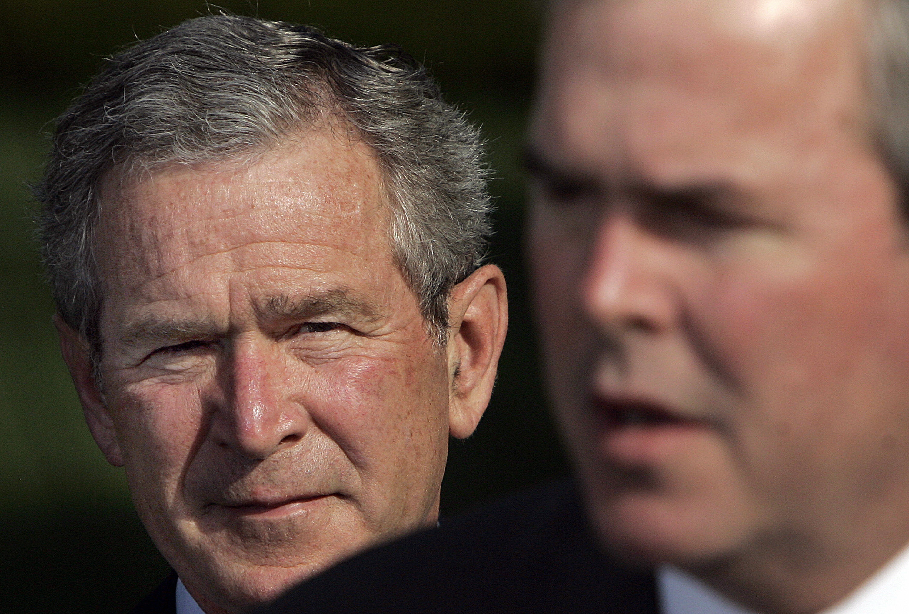 Psst, look behind you: George and Jeb in 2006