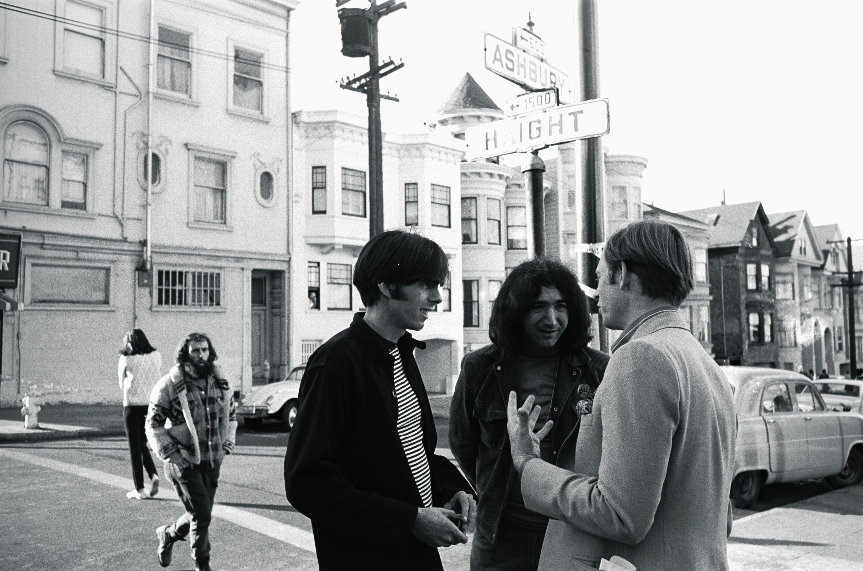"<strong>The Electric Kool-Aid Acid Test</strong> The Dead gained its early audience by performing as the house band at the many LSD parties, known as ""acid tests,"" that were organized widely in the Bay Area in the mid-1960s. The scene, centered on the intersection of Haight and Ashbury streets, was later memorialized in a best-selling work by Tom Wolfe, who stands with Garcia and Dead manager Rock Sculley in this 1966 photo."