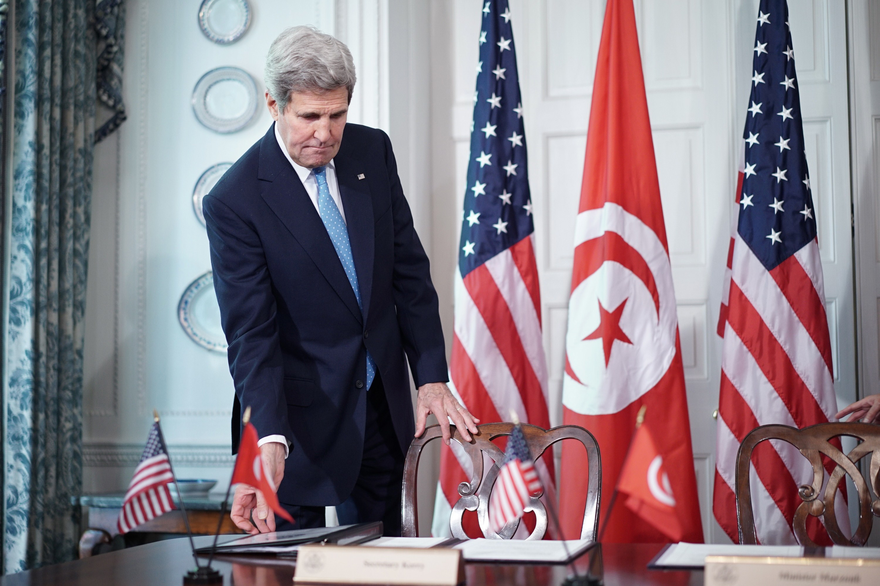 US Secretary of State John Kerry arrives for a signing ceremony for a memorandum of understanding with Tunisian Minister of Political Affairs Mohsen Marzouk at Blair House, the presidential guest house, on May 20, 2015 in Washington, DC.