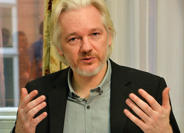 WikiLeaks founder Julian Assange gestures during a press conference inside the Ecuadorian embassy in London on Aug. 18, 2014