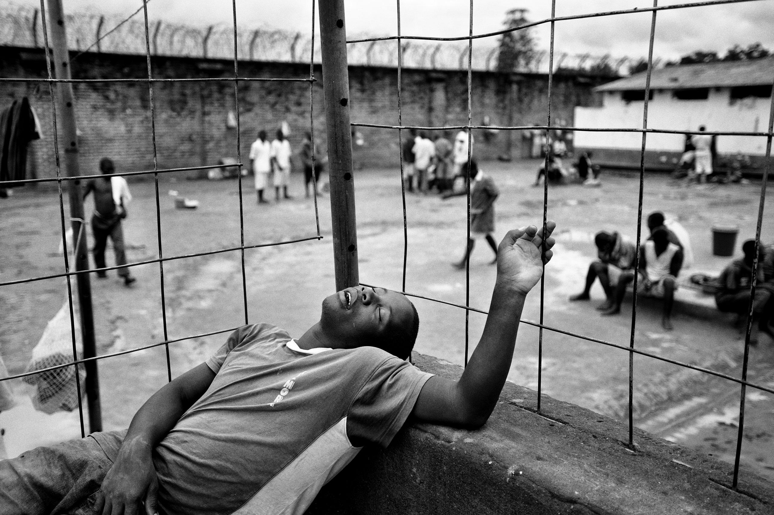 A juvenile prisoner takes a nap.