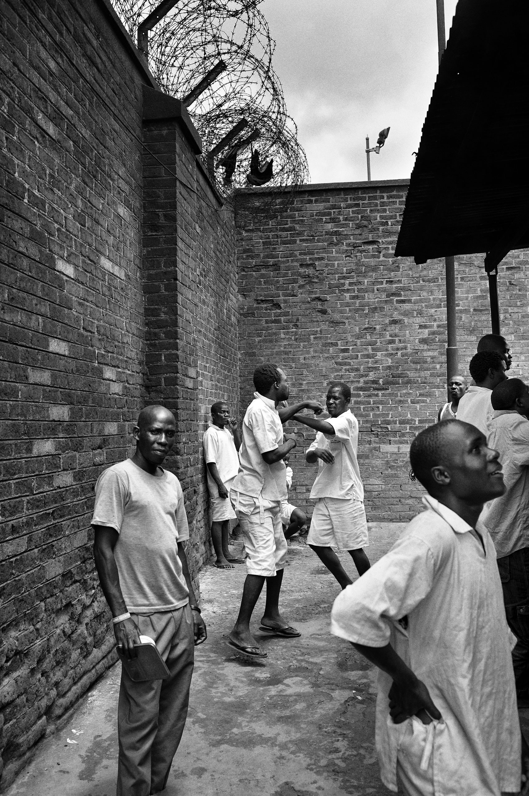 Inmates wait in line to receive food once a day.