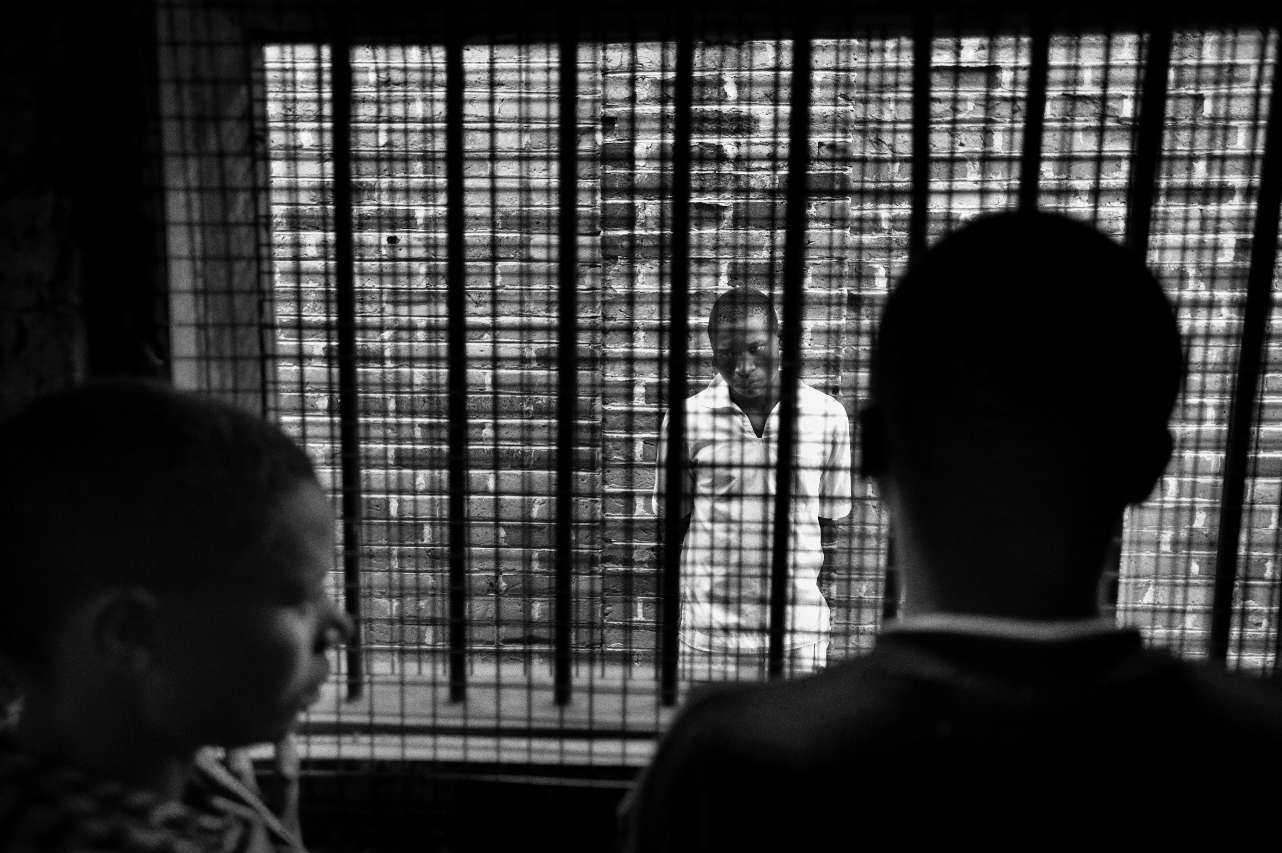Balaka Mgode's parents visit their son at the Juvenile prison in Mzuzu, Malawi. They are not allowed to touch each other. Mgode has been sentenced to three and a half years in prison for stealing a phone.
