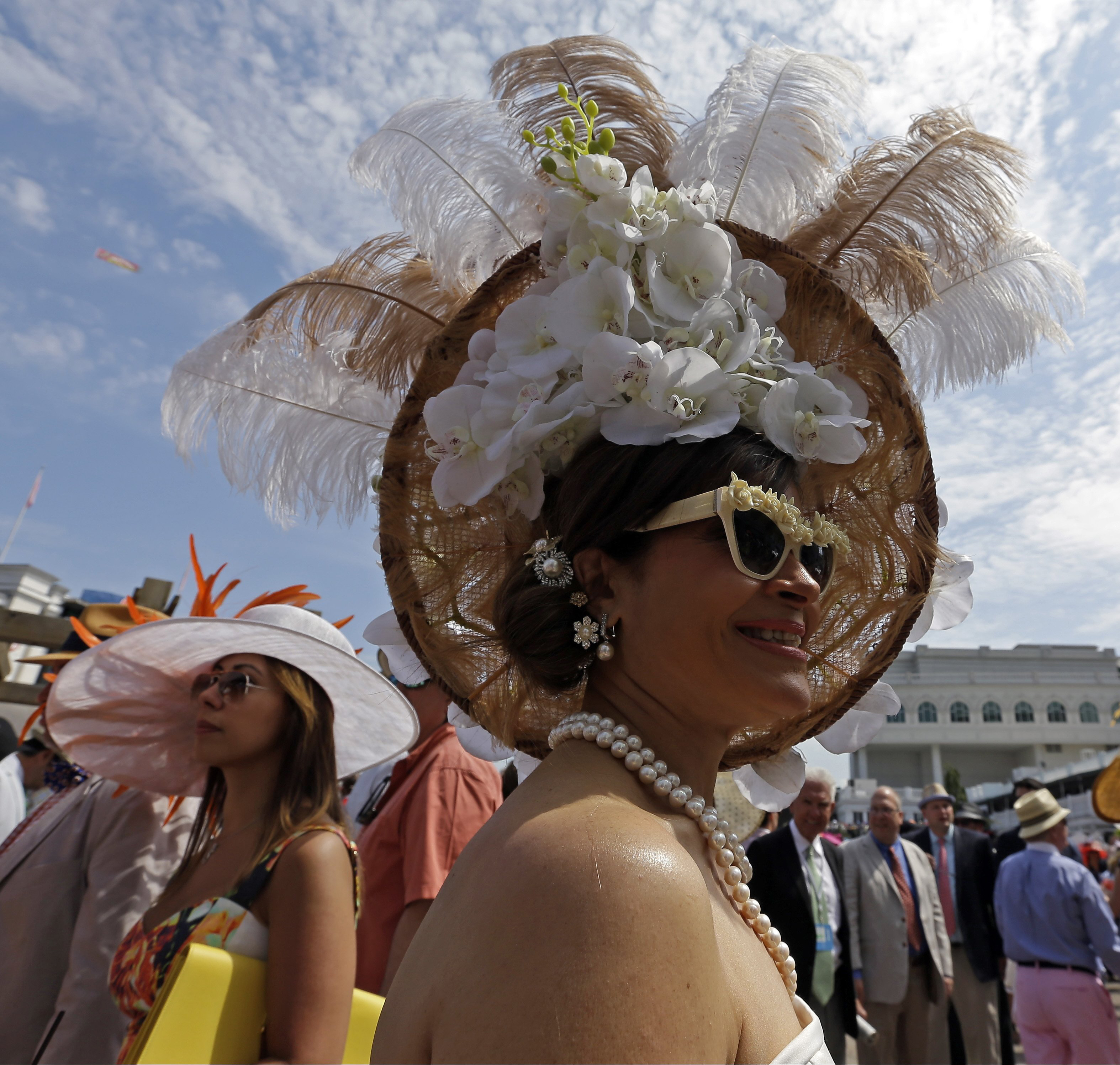 Woman with a hat during the 141st running of the Kentucky Oaks horse race at Churchill Downs on May 2, 2015, in Louisville, Ky.
