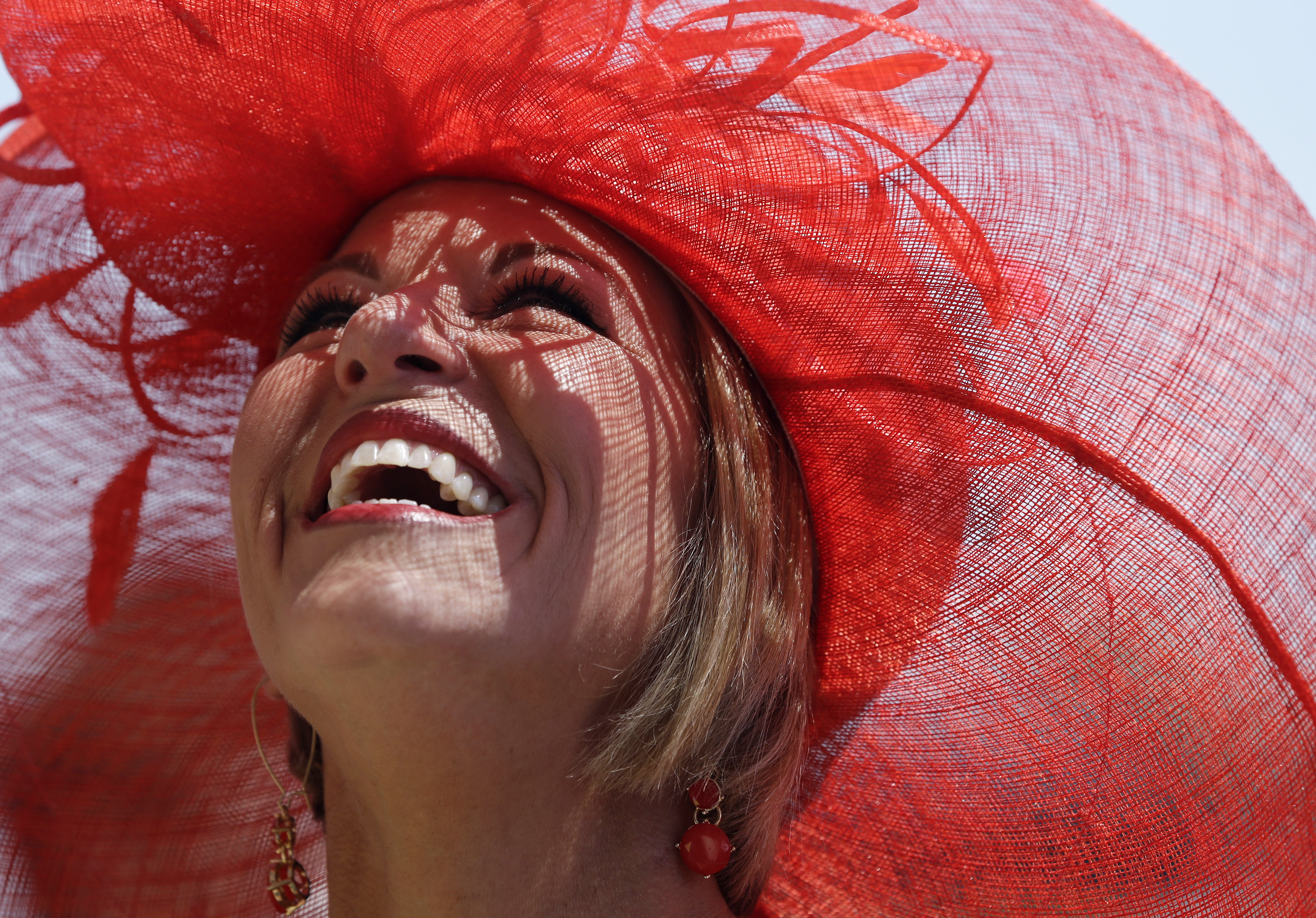 Woman with a hat during the 141st running of the Kentucky Oaks horse race at Churchill Downs on May 1, 2015, in Louisville, Ky.