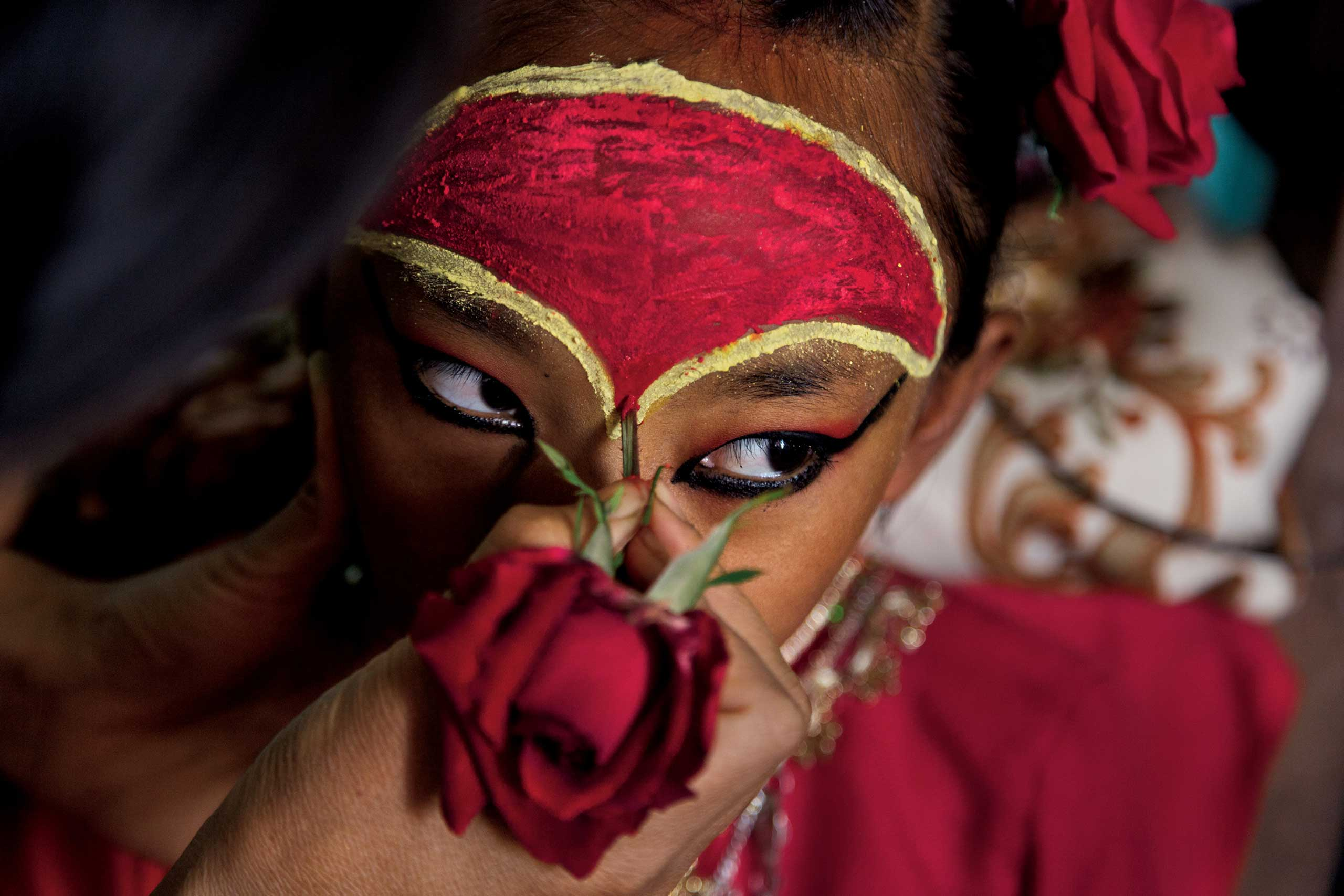 From the June  issue of National Geographic magazine: Living Goddesses of Nepal                               The Kumari of Tokha, nine-year-old Dangol, became a living goddess as an infant. A kumari's eyes are believed to draw the beholder into direct contact with the divine. For religious festivals her forehead is painted red, a sign of creative energy.