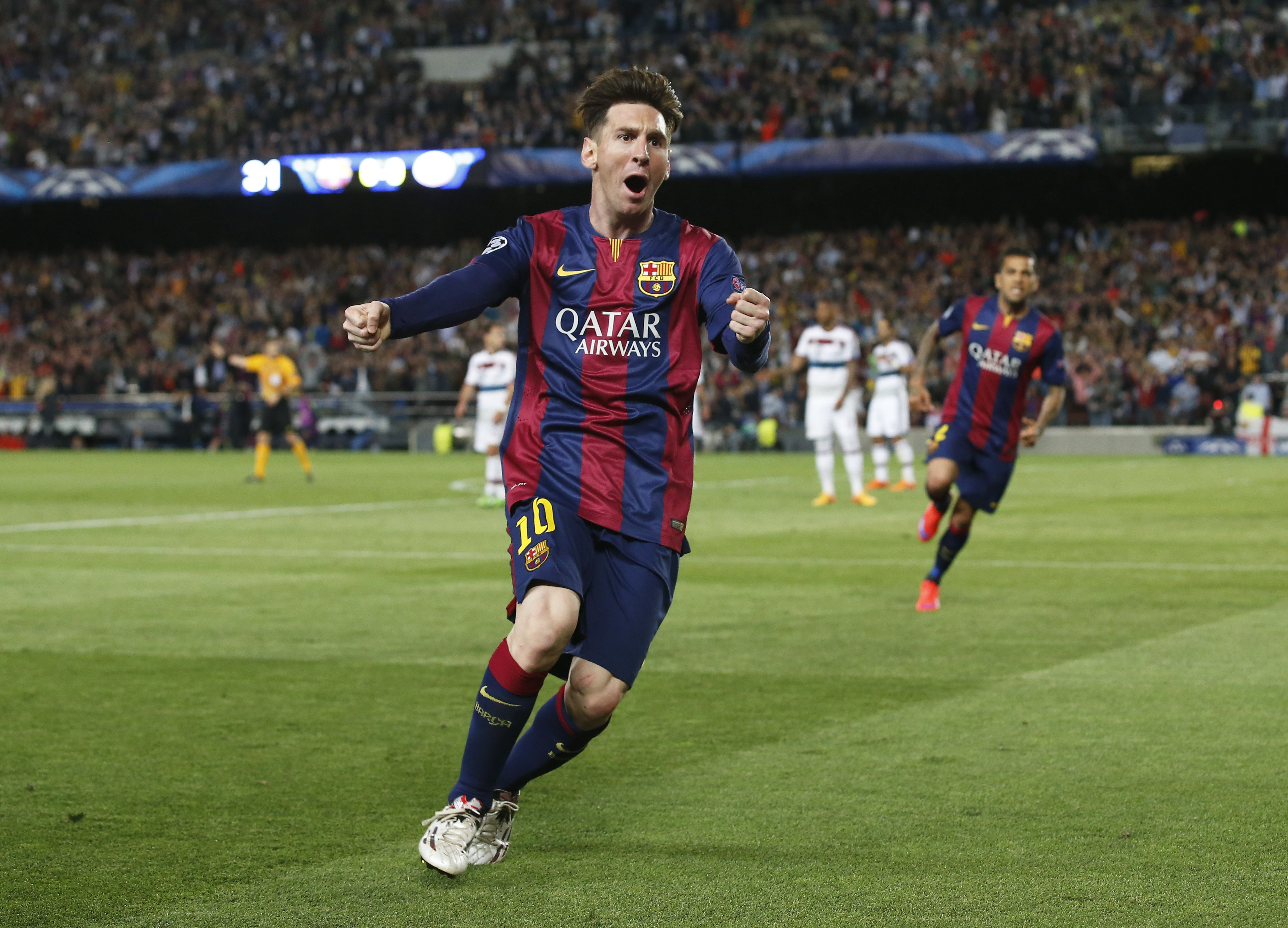Barcelona's Lionel Messi celebrates his first goal  against Bayern Munich in the UEFA Champions League Semi Final First Leg at The Nou Camp in Barcelona on May 5, 2015.
