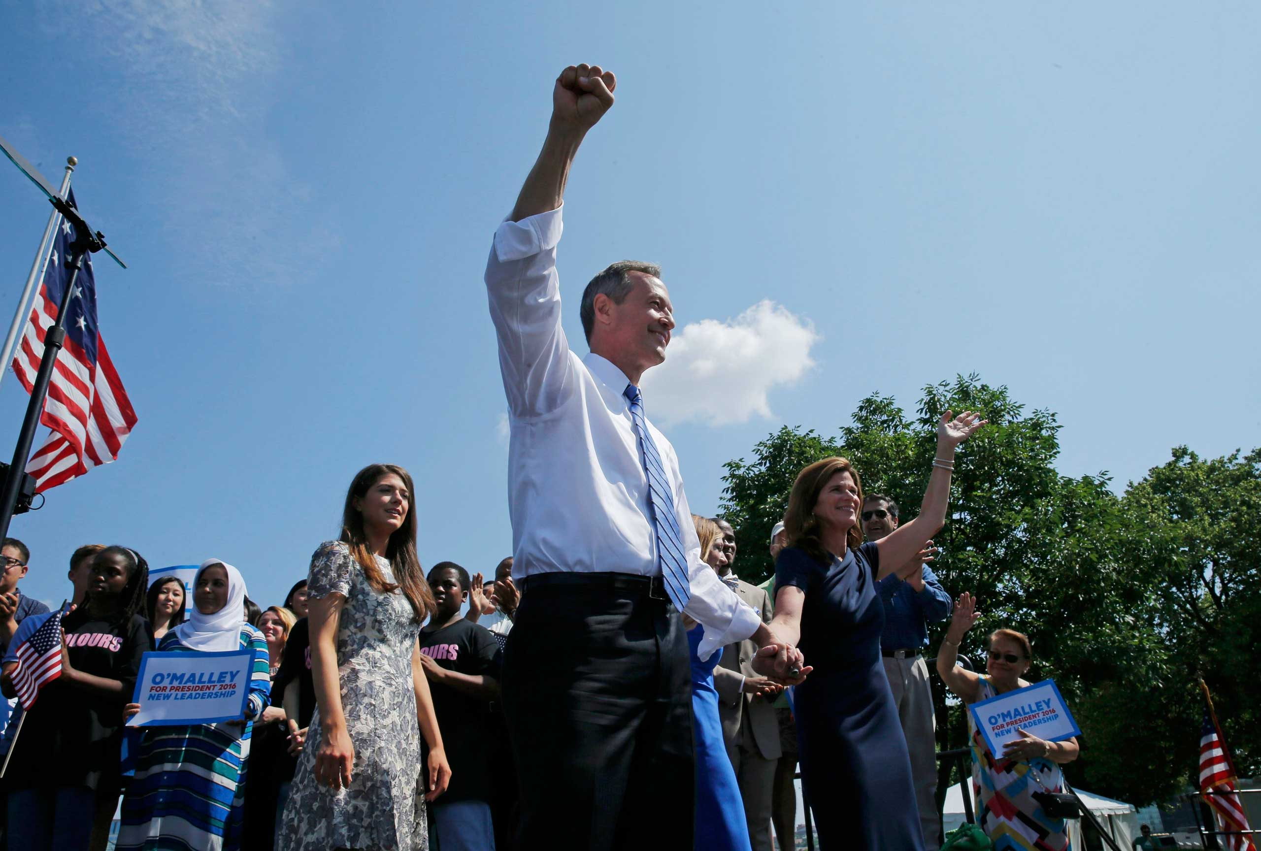 Former Maryland Governor Martin O'Malley is joined by his wife Katie O'Malley (R) as he announces his intention to seek the Democratic presidential nomination during a speech at Federal Hill Park in Baltimore on May 30, 2015.