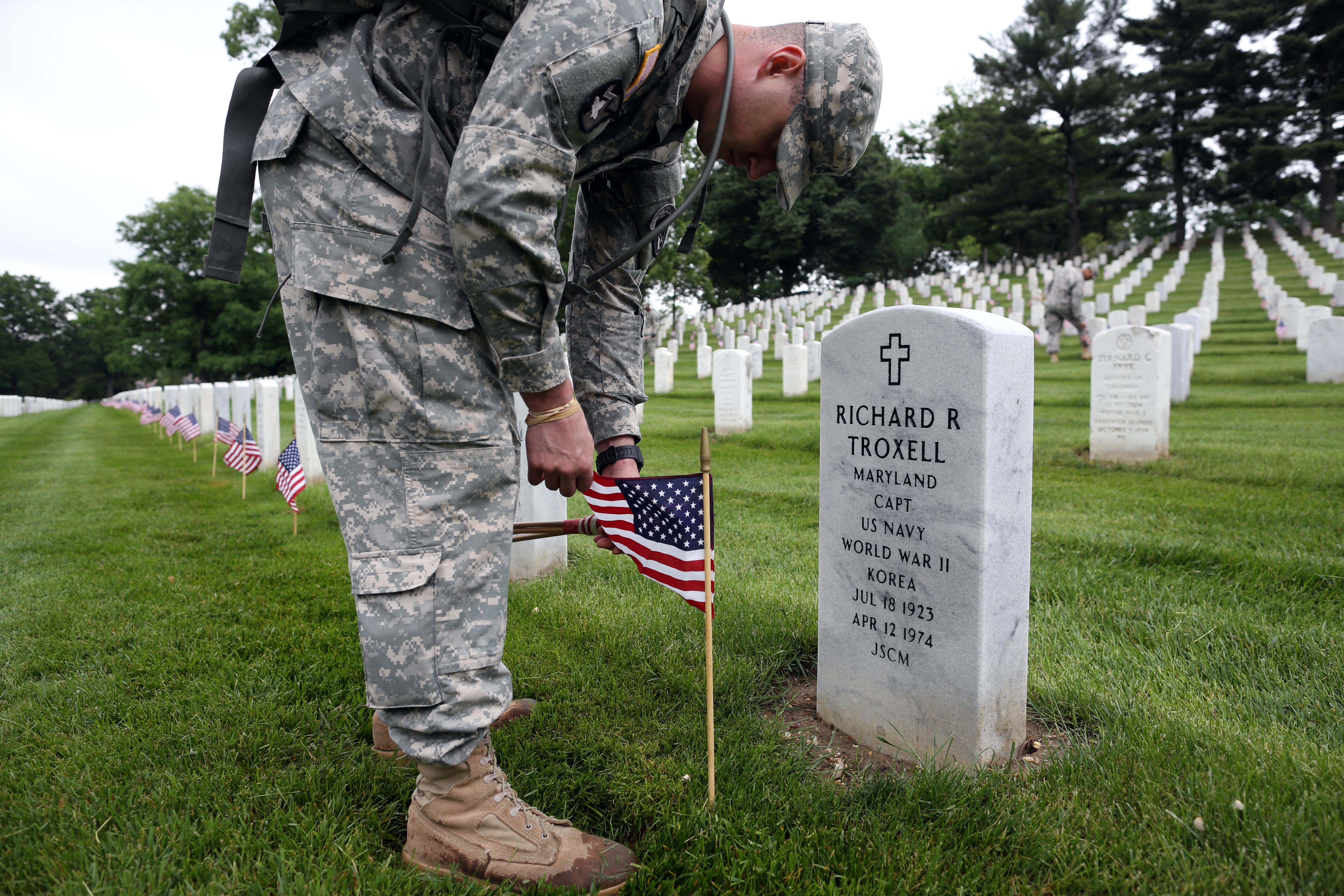 Over 1,000 members of the U.S. Infantry Regiment (The Old Guard) place 228,000 flags at headstones for Memorial Day weekend at Arlington National Cemetery in Arlington, Va. on on May 21, 2015.