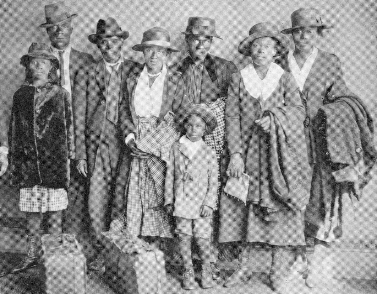 African American men, women, and children who participated in the Great Migration to the north, in Chicago, 1918.