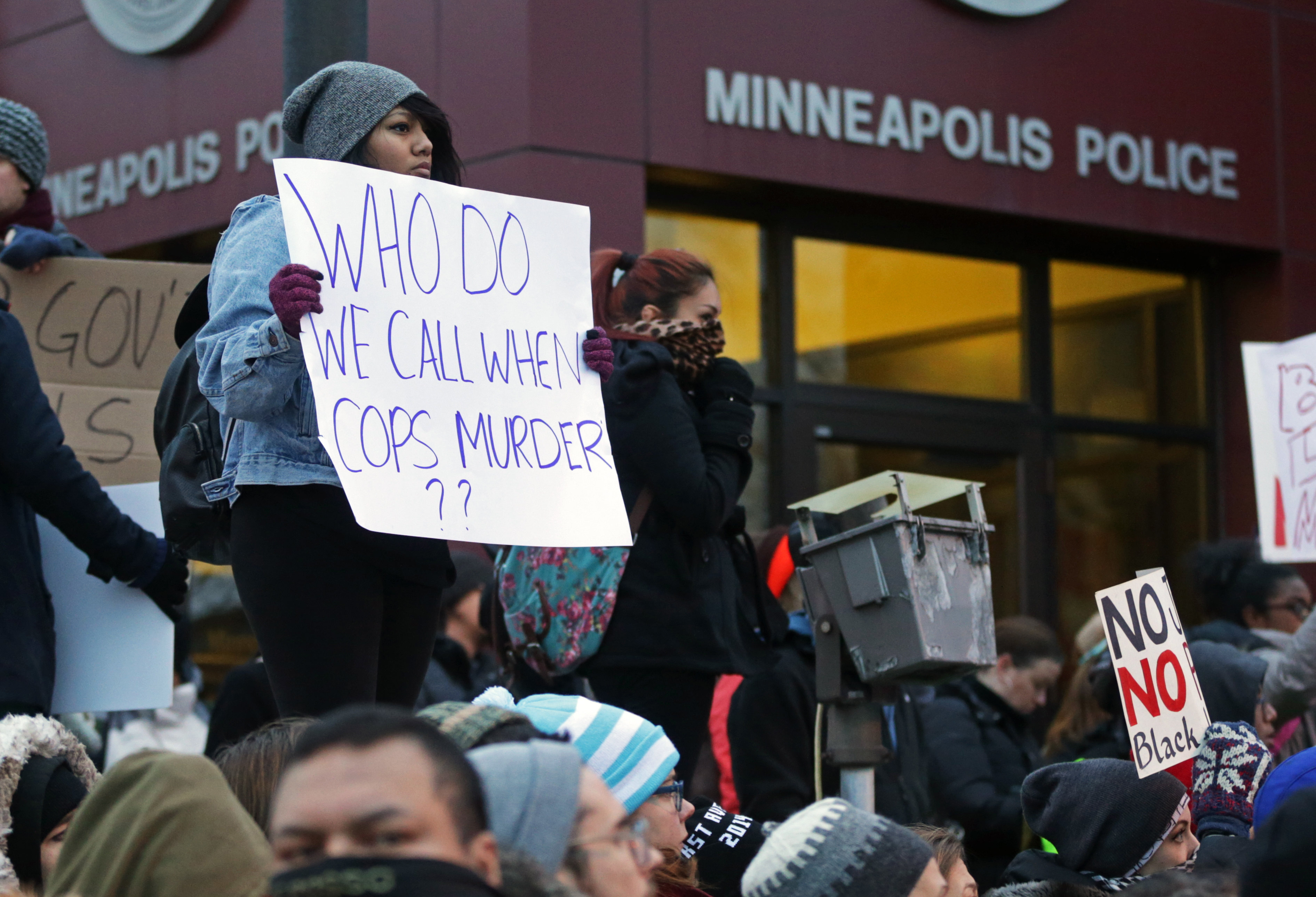 Demonstrators rally outside the Minneapolis Police Department's Third Precinct to protest police brutality, on Nov. 25, 2014, in Minneapolis.