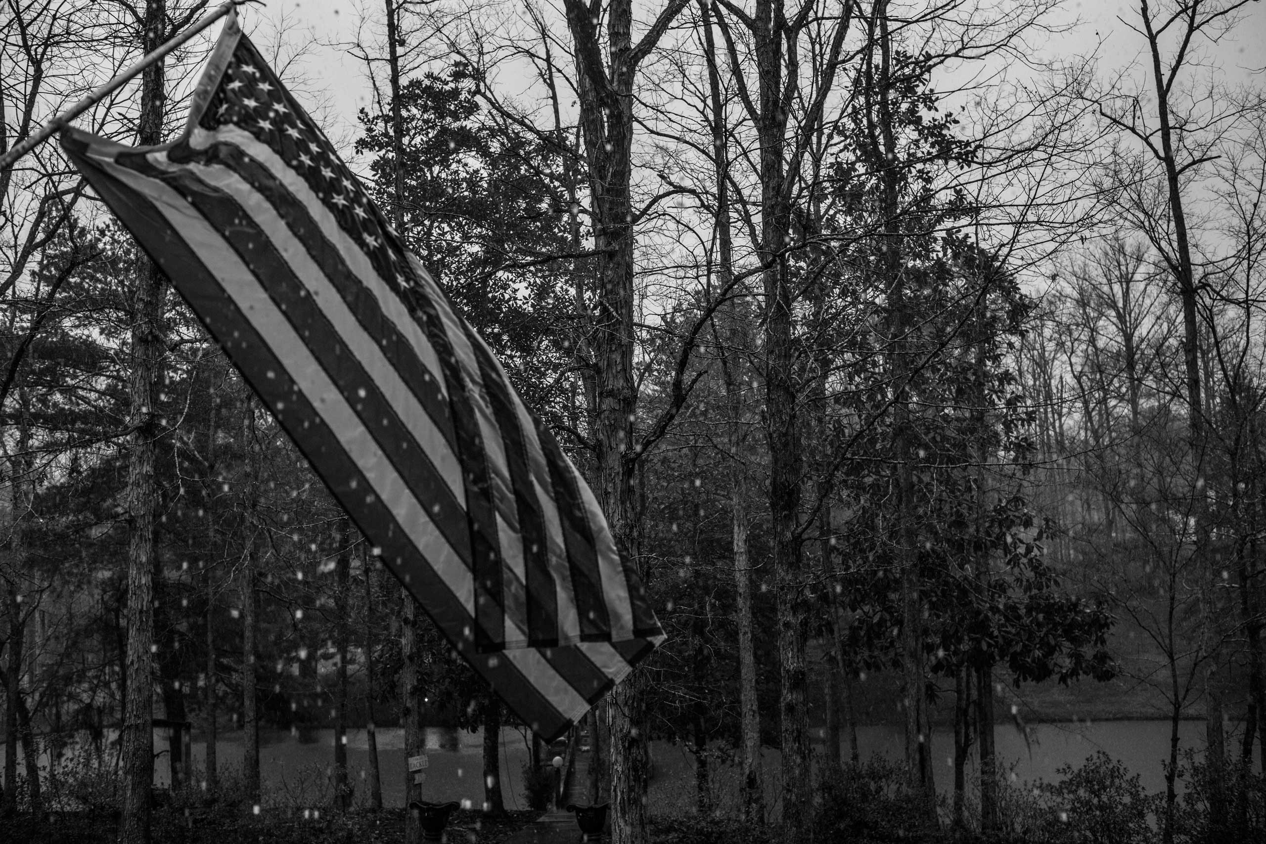 Shawn Bleeker, Ozark, Ala.                                                              A flag hangs in a rain storm from the front porch of Shawn Bleeker's former home in Ozark, Alabama.