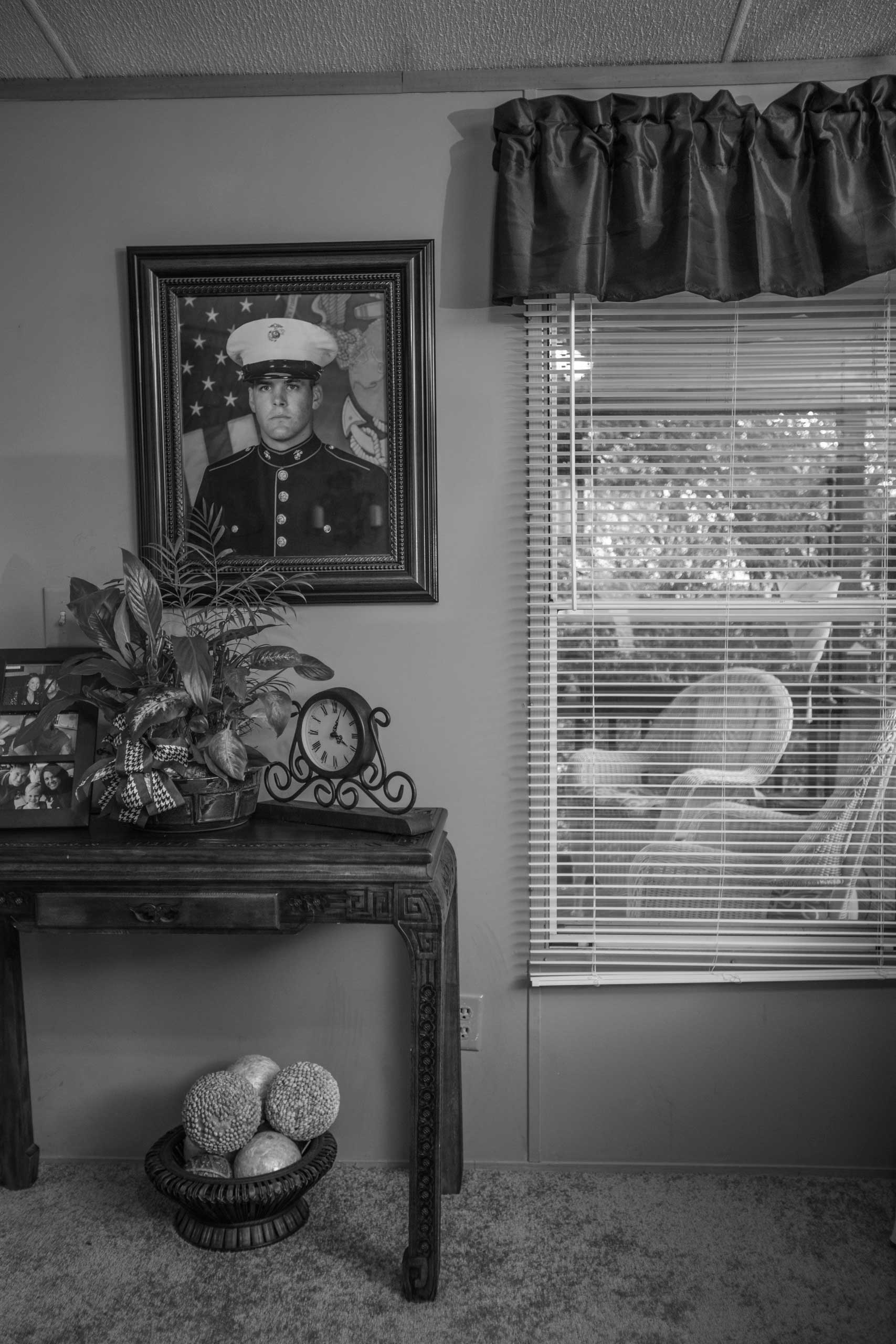 Brandon Ladner. Pelham, Ala.                                                              A large portrait of Brandon Ladner hangs in the living room of his former home in Pelham, Alabama. Brandon was a U.S. Marine Corps Veteran. He fought in Afghanistan's Helmand Province.