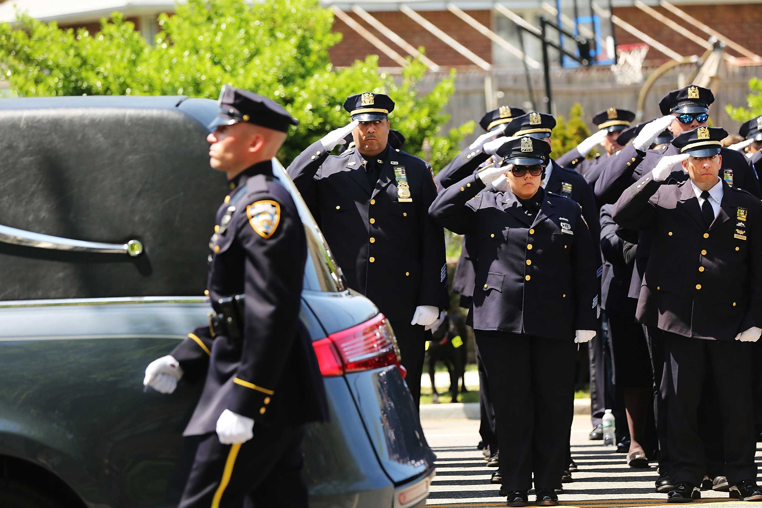 The funeral of police officer Brian Moore, who died last Monday after being shot in the head while on duty two days earlier in Queens, in Seaford, N.Y., on May 8, 2015.