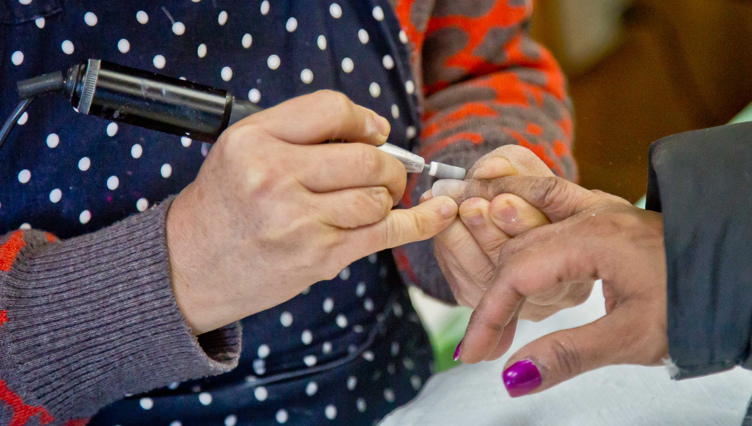 A customer receives a manicure at Castle nail salon in New York City on Jan. 8, 2015.