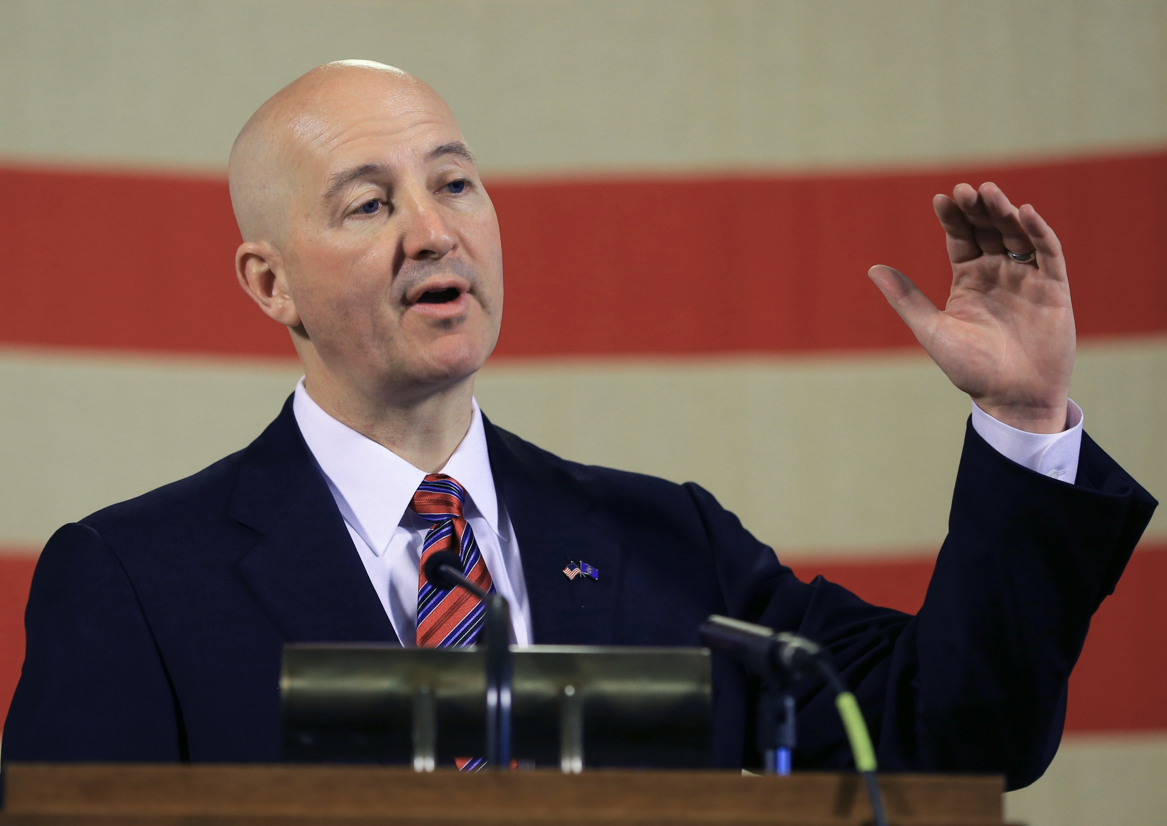 Neb. Gov. Pete Ricketts gestures during a news conference in Lincoln, Neb. on May 20, 2015.