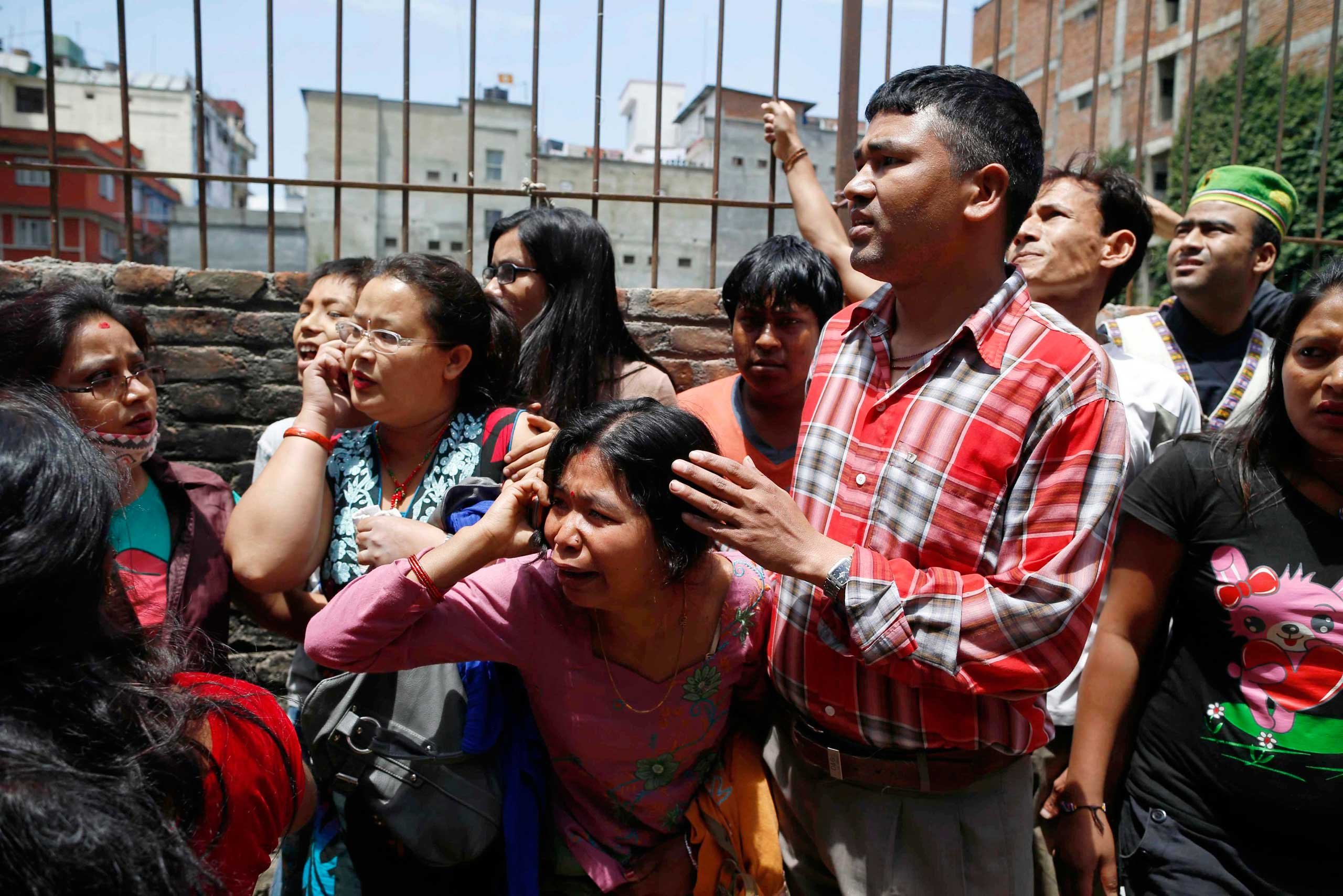 Nepalese run for open space as a strong earthquake hits Kathmandu on May 12, 2015.