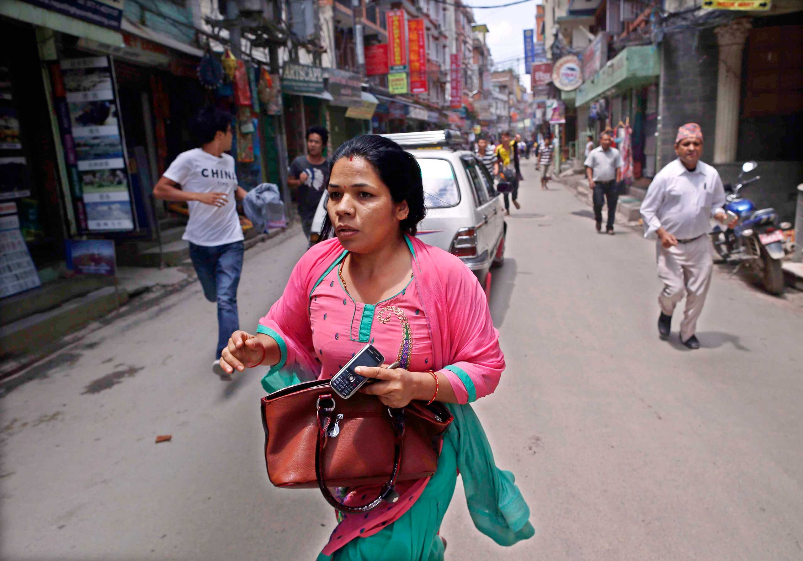 Nepalese search for open space as a strong earthquake hits Kathmandu on May 12, 2015.