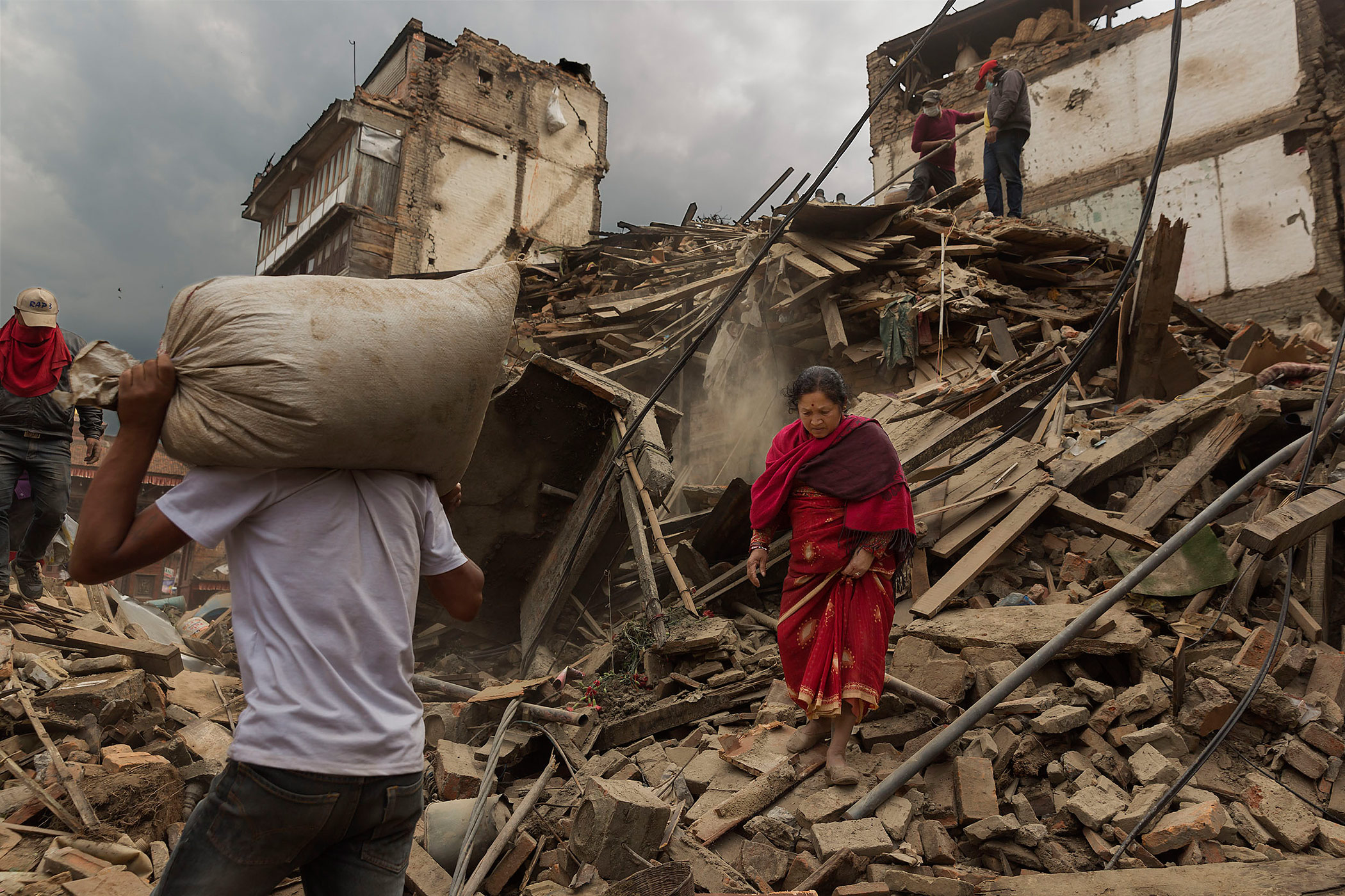 People reclaim their possessions from the wreckage in Bhaktapur, Nepal.