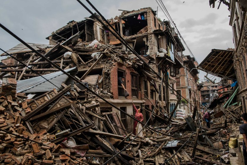 Residents recover personal belongings in the rubble of their destroyed home in Bhaktapur.