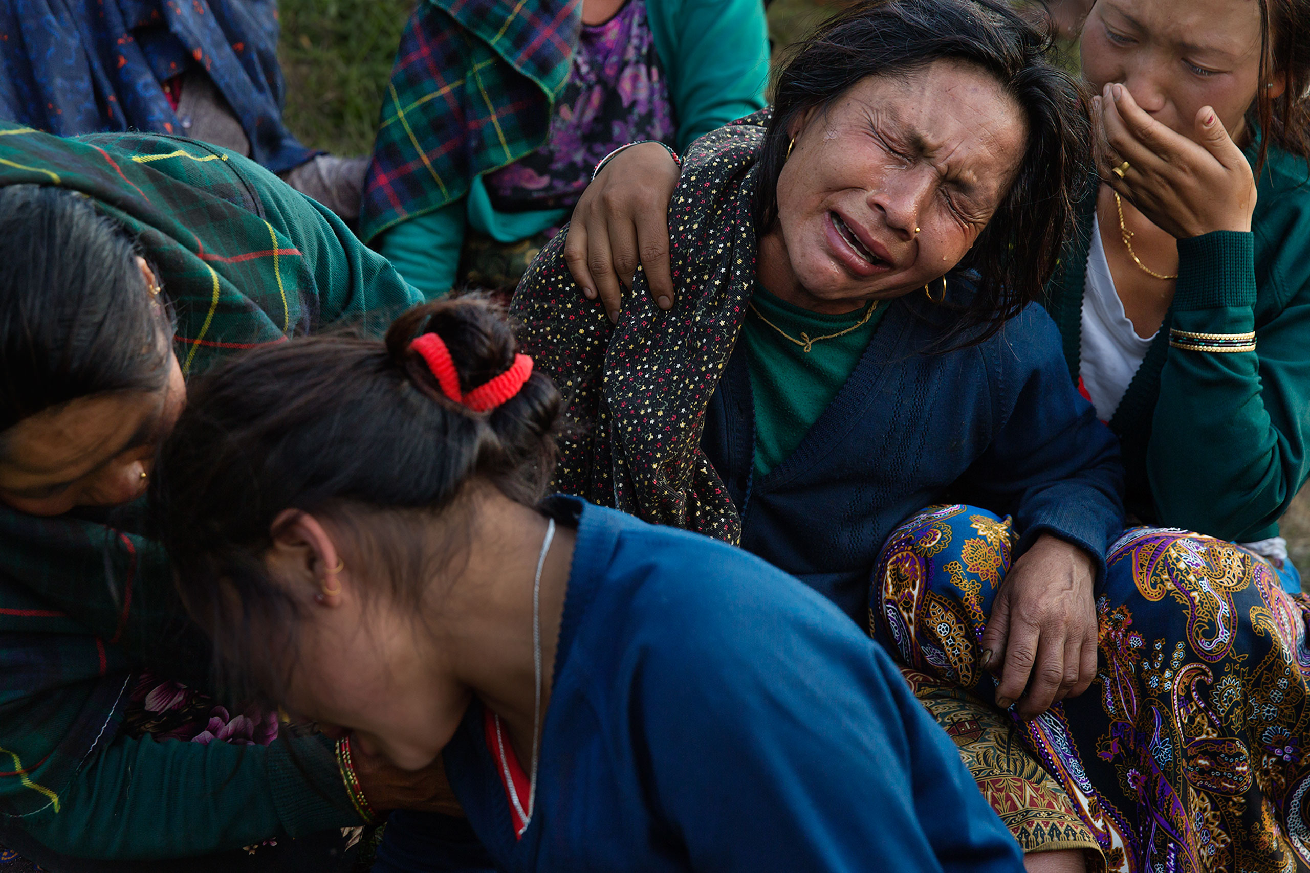 Saainli Gurung weeps during the funeral of her son, Pur Bahadur Gurung, 26, who was found in the rubble in Barpak, Nepal, May 5, 2015.