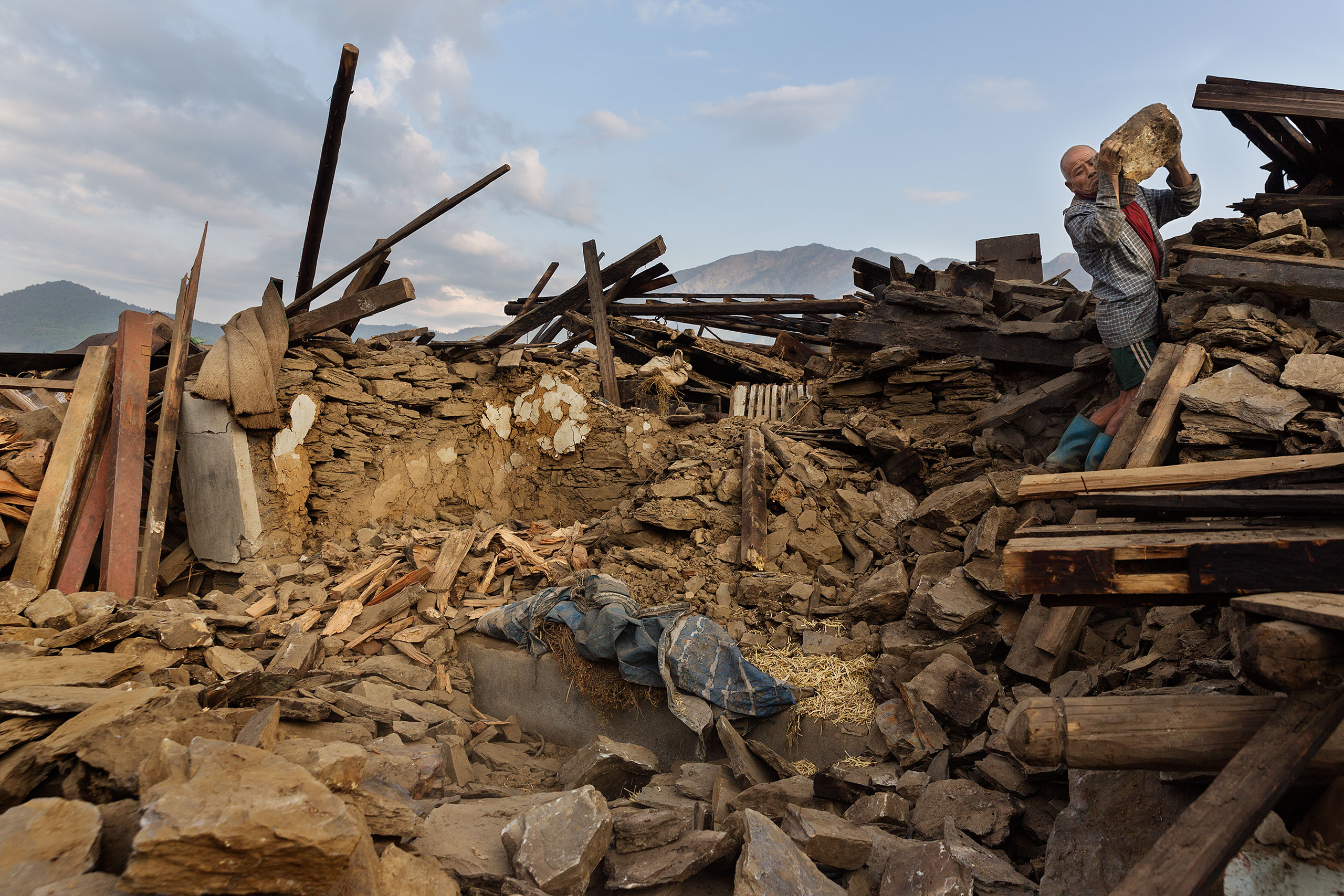Villagers look through rubble in Barpak, Nepal, May 5, 2015.