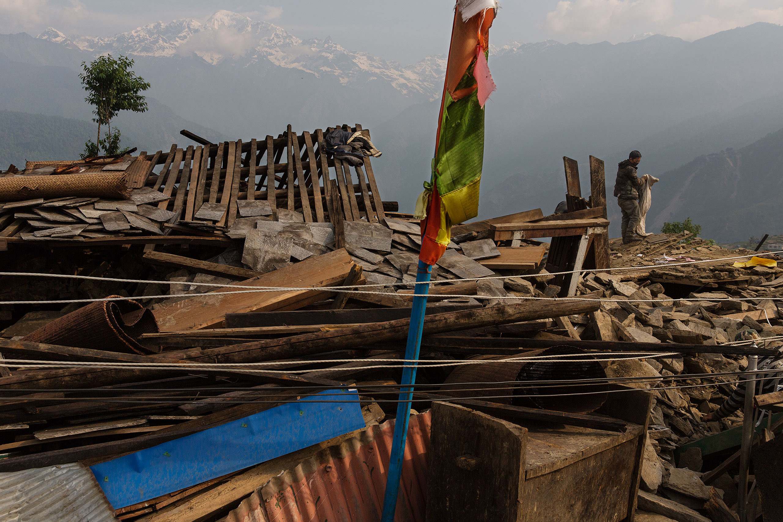 In Barpak, the epicenter of the earthquake, inhabitants sift through the wreckage looking for possessions from their destroyed houses, May 6, 2015.