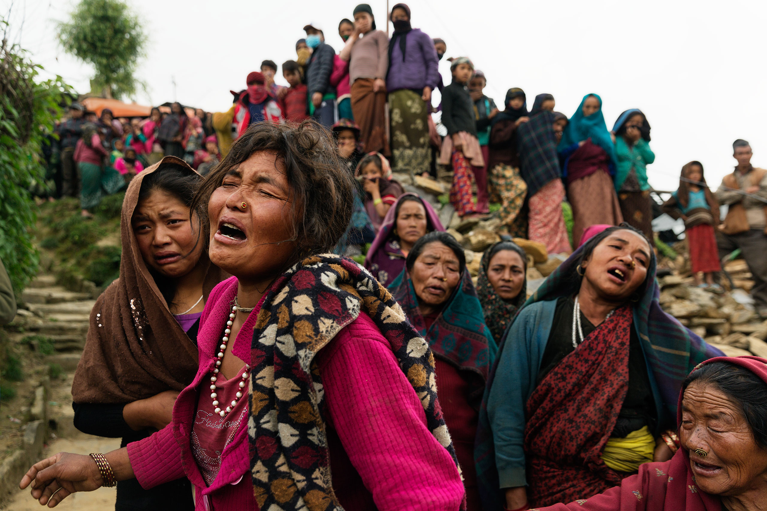 TIME LightBox: NepalBishnu Gurung sobs after her 3-year-old daughter, Rejina Gurung, was found buried in the rubble in the village of Gumda in Gorkha district, near the epicenter of last month's Nepal earthquake, on May 8, 2015. The baby's father is a guest worker in Malaysia.