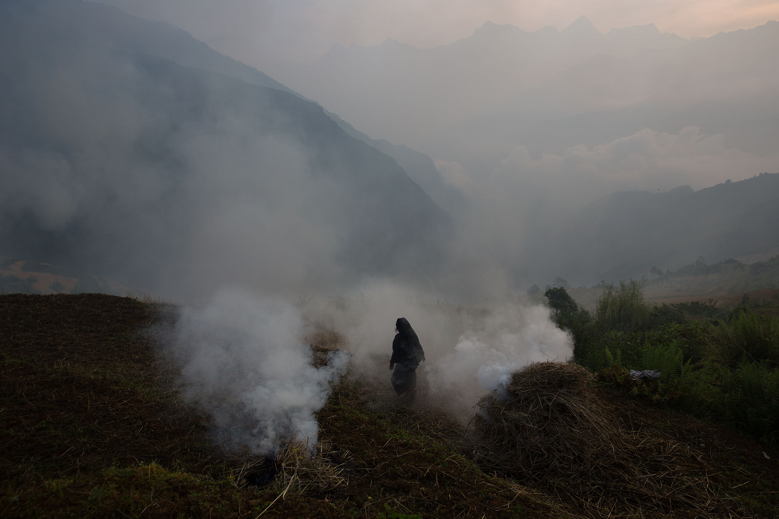A woman walks in the remote village of Gumda in Ghorka district, Nepal, May 8, 2015.