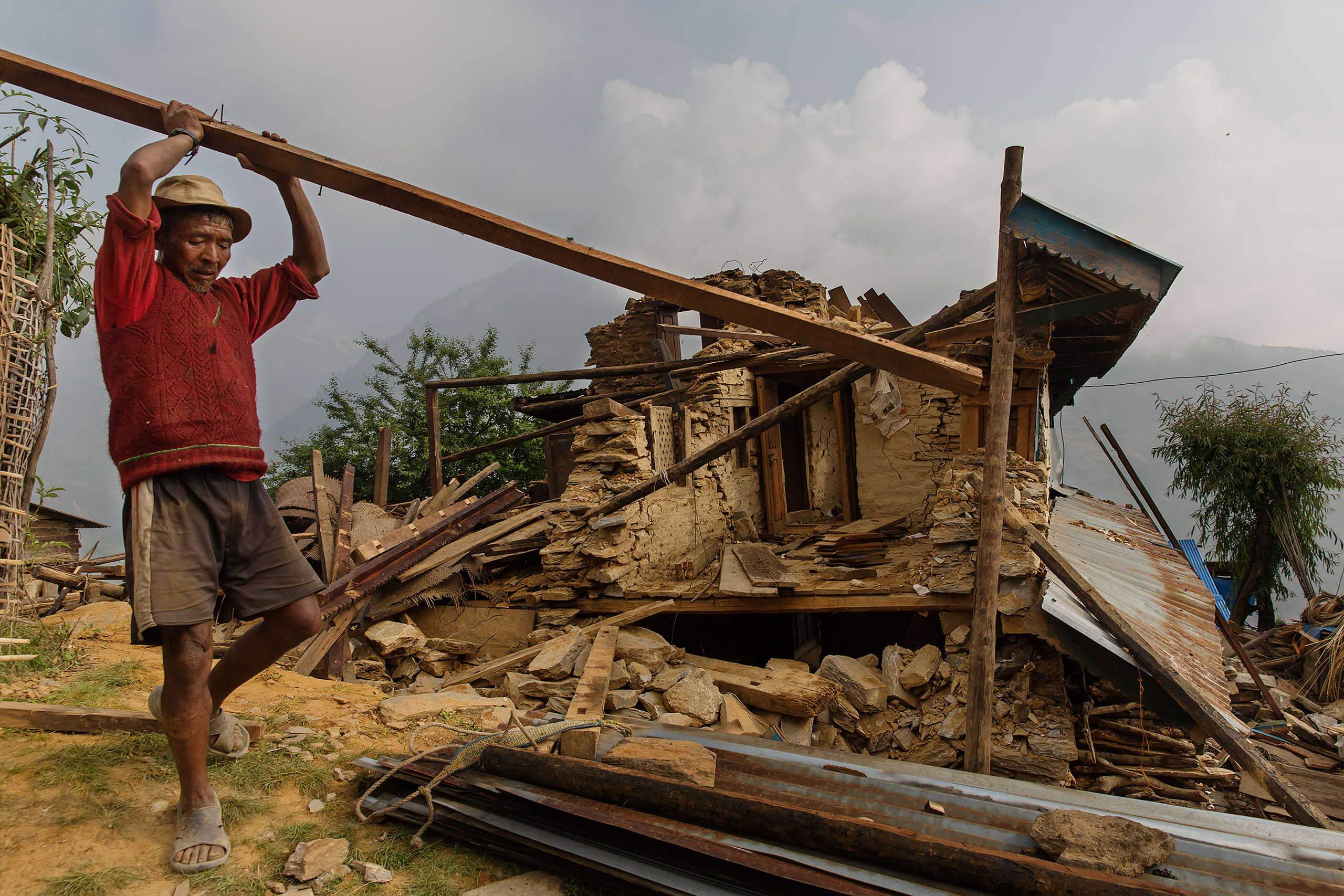 A villager salvages building supplies in Gumda, in the Gorkha district of Nepal, May 8, 2015.