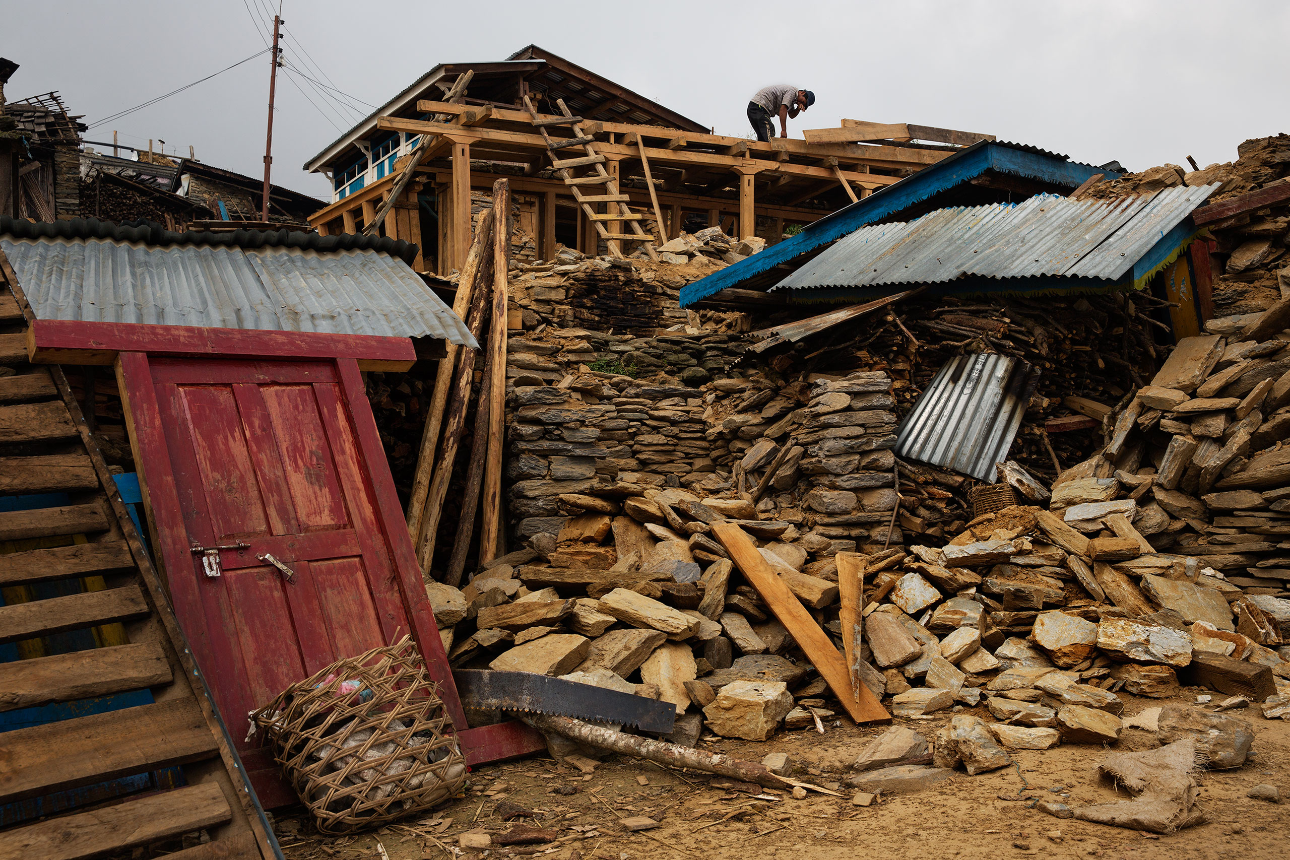 Inhabitants salvage building materials from their destroyed homes in Gumda Village, near the epicenter of  the earthquake in Gorkha district, where five people died and 14 are still missing in landslides, May 8, 2015.