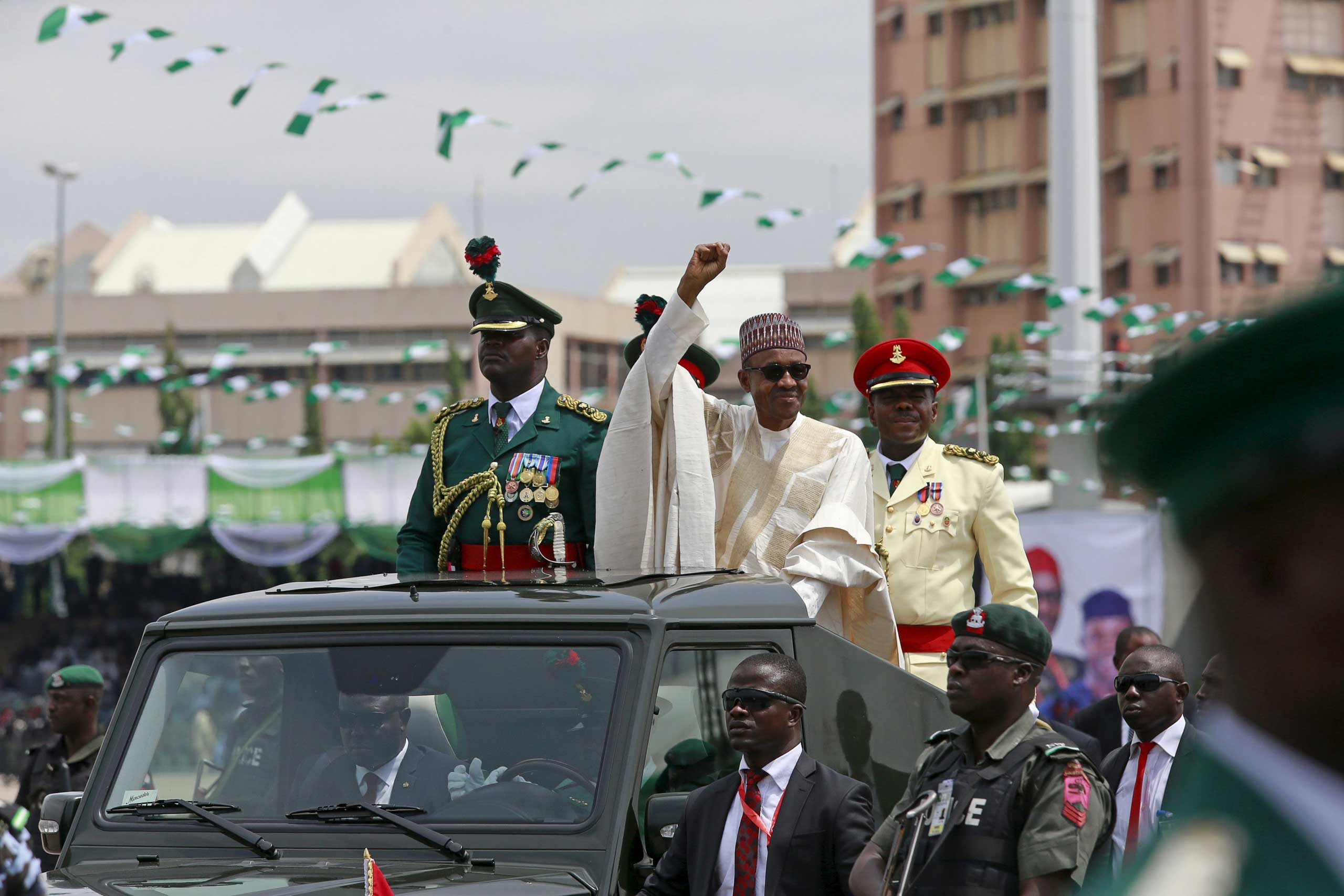 Nigeria's new President Muhammadu Buhari rides in a motorcade while inspecting the guard of honour before his inauguration at Eagle Square in Abuja, Nigeria on May 29, 2015.