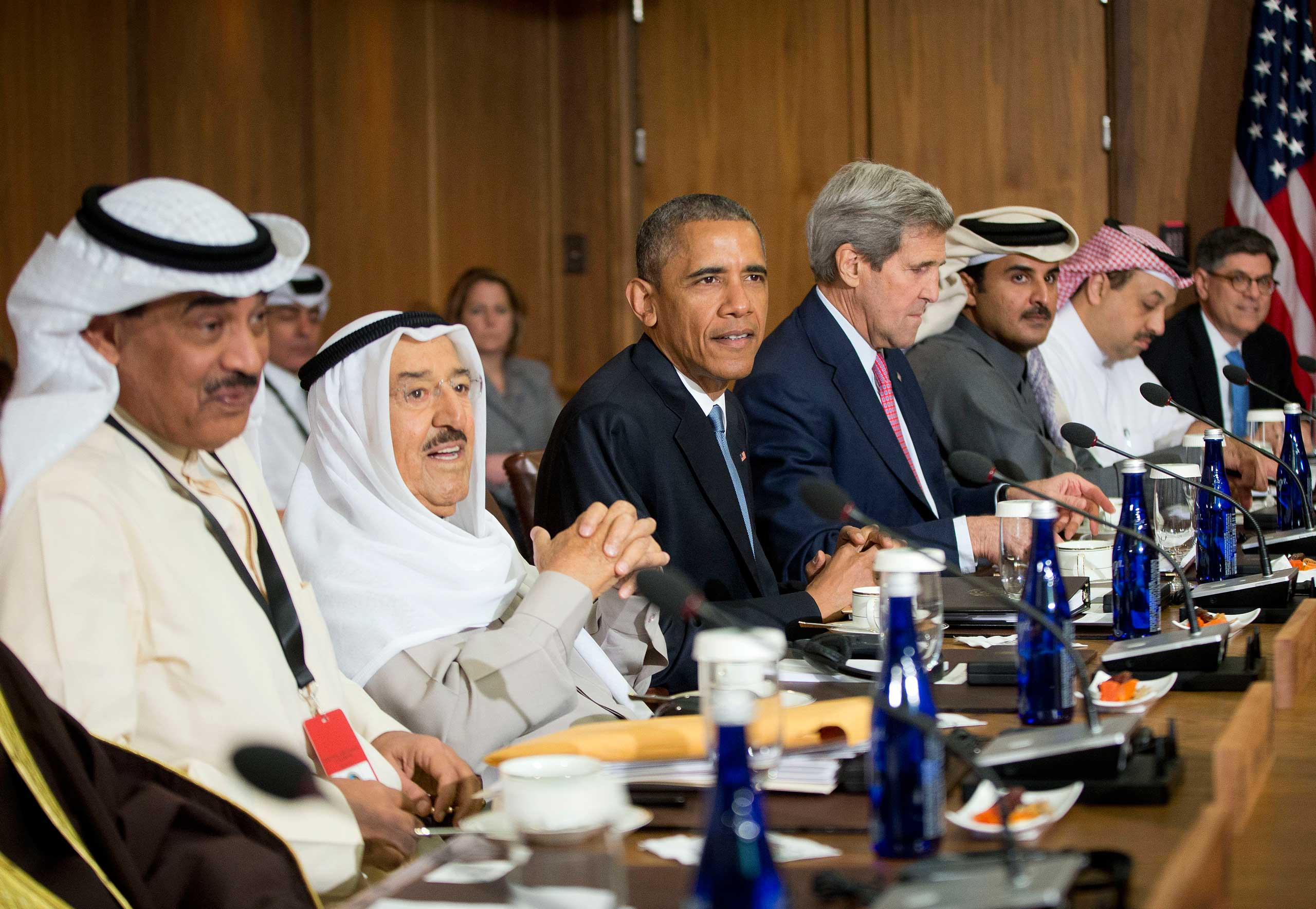 President Barack Obama sits with Kuwaiti Emir Sheikh Sabah Al-Ahmad Al-Sabah, left center, Secretary of State John Kerry, right center, and other Gulf Cooperation Council leaders and delegations at Camp David, Md., on May 14, 2015.