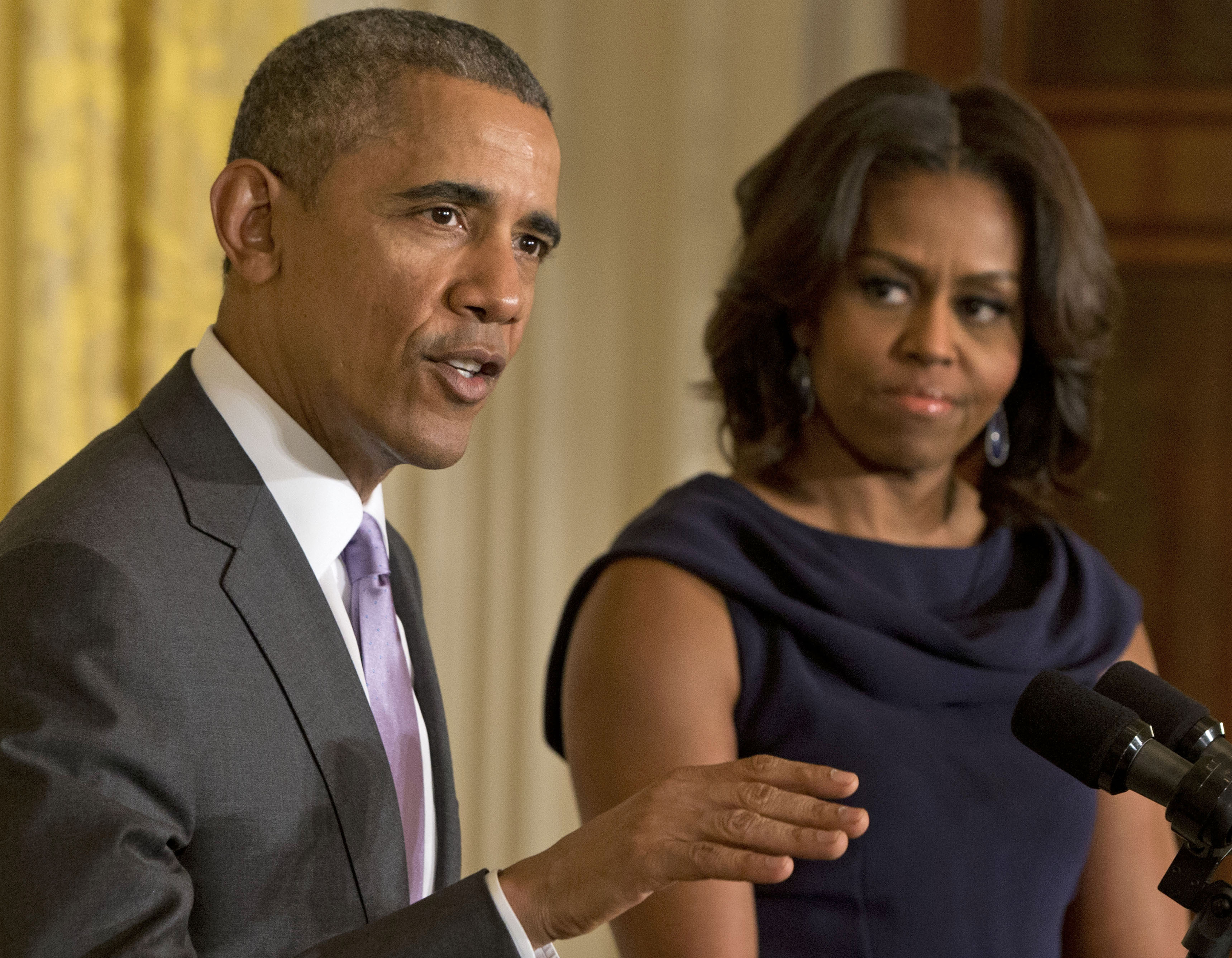 In this March 3, 2015 file photo, President Barack Obama, accompanied by first lady Michelle Obama, speaks in the East Room of the White House in Washington.