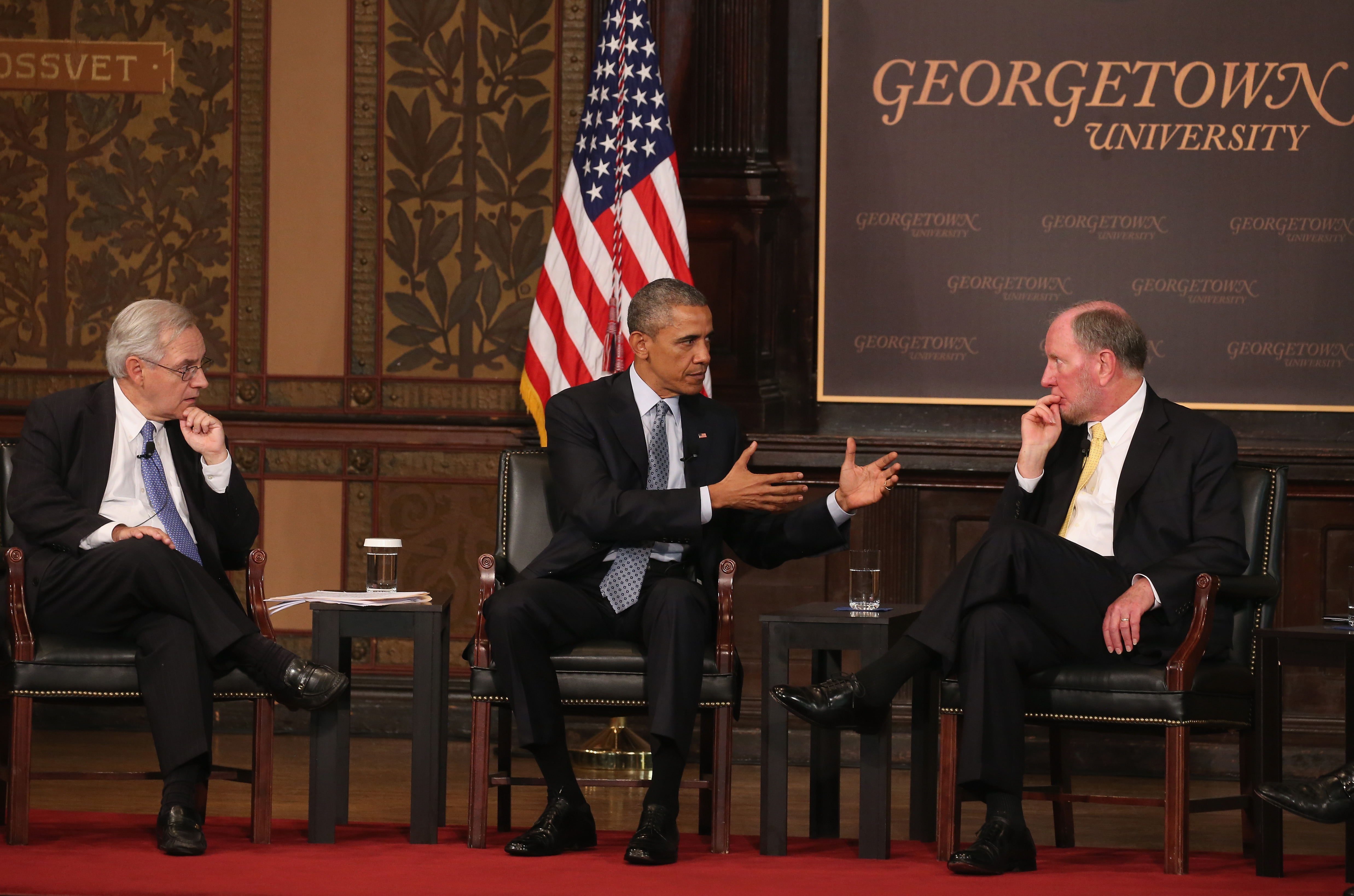 President Barack Obama participates in a discussion on poverty with moderator E.J. Dionne, Jr. and Robert Putman Professor at Harvard University, at Georgetown University May 12, 2015 in Washington, DC.