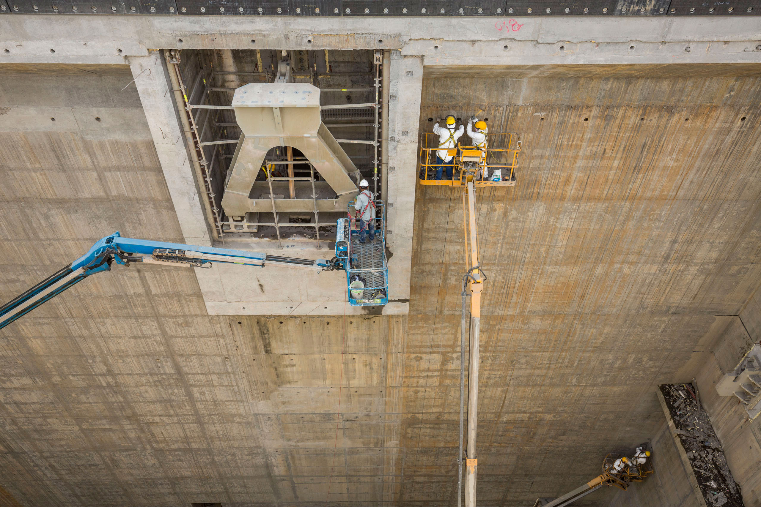 Workers make final refinements to the concrete and steel slot that will hold the last gate on the Pacific side of the Panama Canal Expansion project, April 23, 2015.