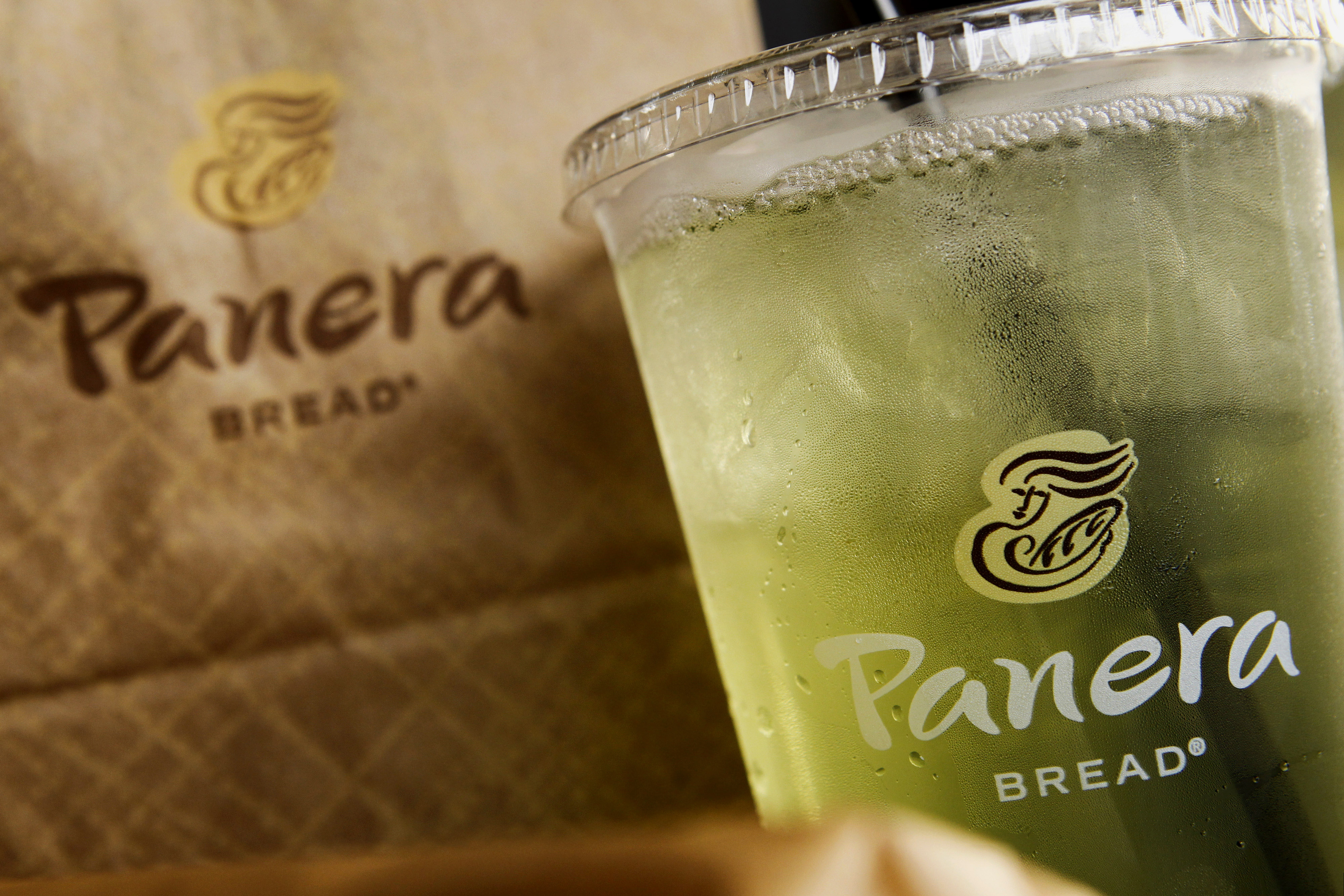 The Panera Bread Co. logo is seen on a cup of iced tea and a bag arranged for a photograph outside of a restaurant in Torrance, California, on Oct. 21, 2013.
