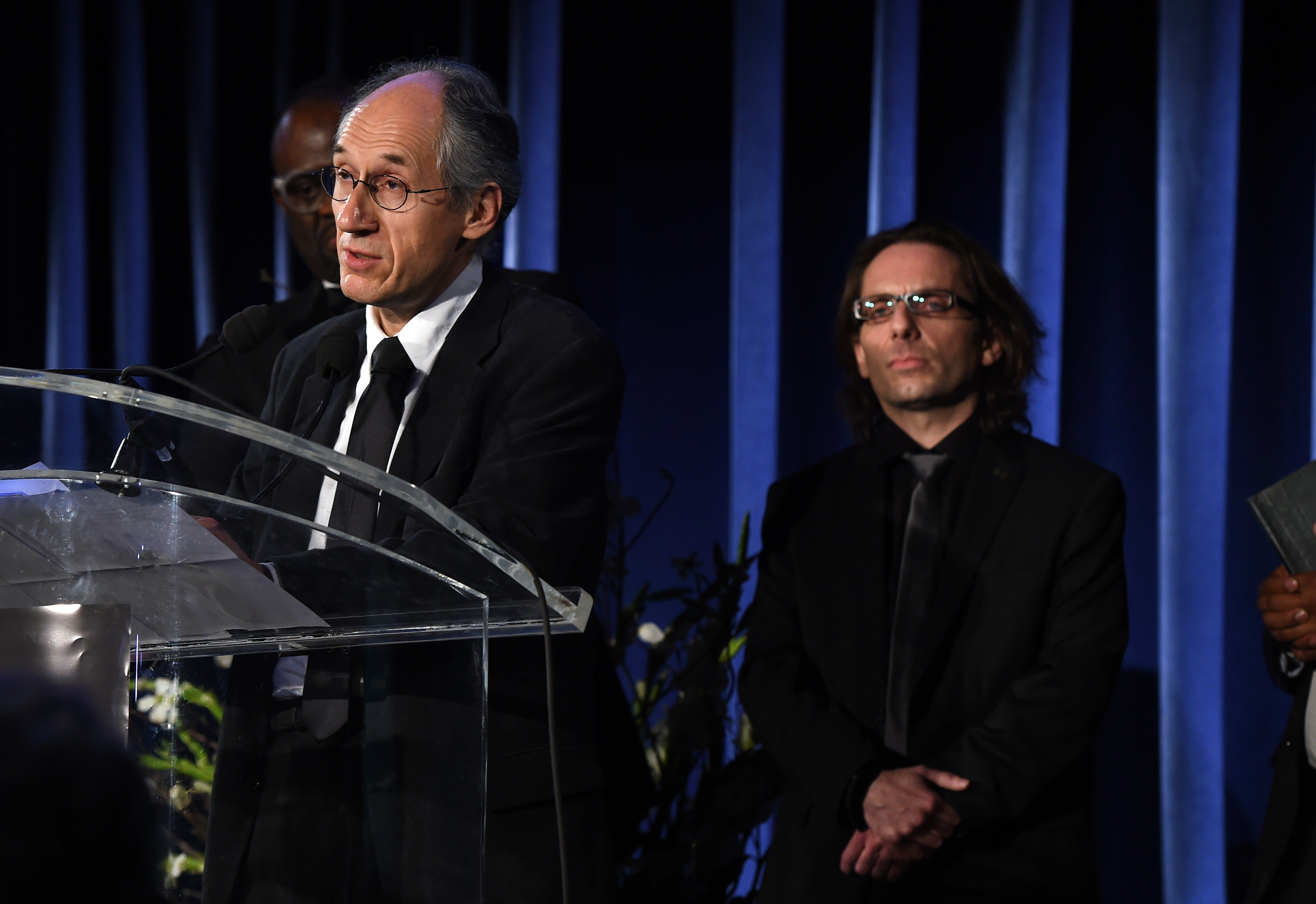 Gerard Biard, left, editor-in-chief of the Paris-based satirical weekly Charlie Hebdo, speaks before critic Jean-Baptiste Thoret (R) during the annual PEN American Center Literary Gala May 5, 2015 at the American Museum of Natural History in New York