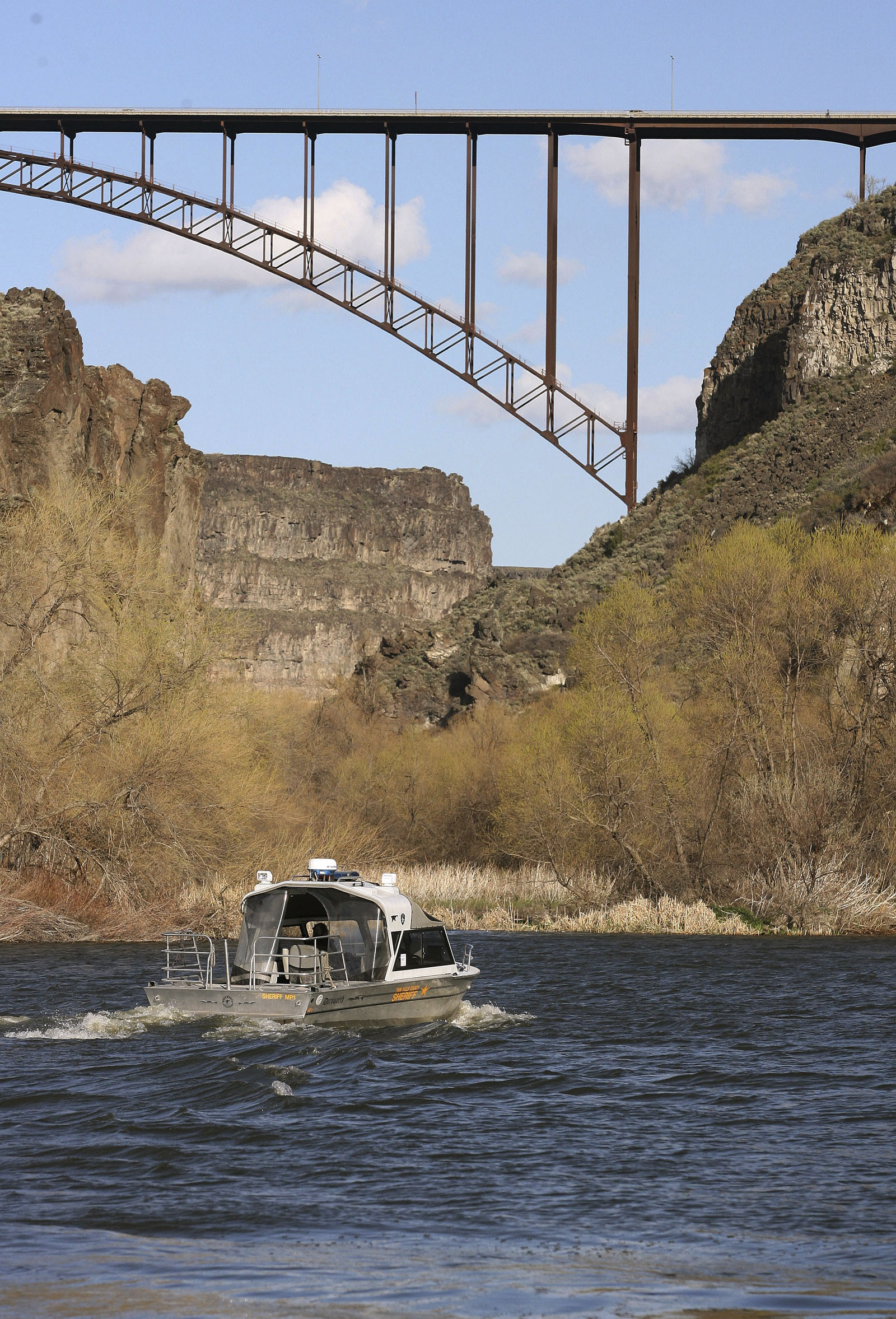 A Twin Falls County Sheriff Department Search and Rescue boat heads up the Snake River on April 10, 2007, in Twin Falls, Idaho.